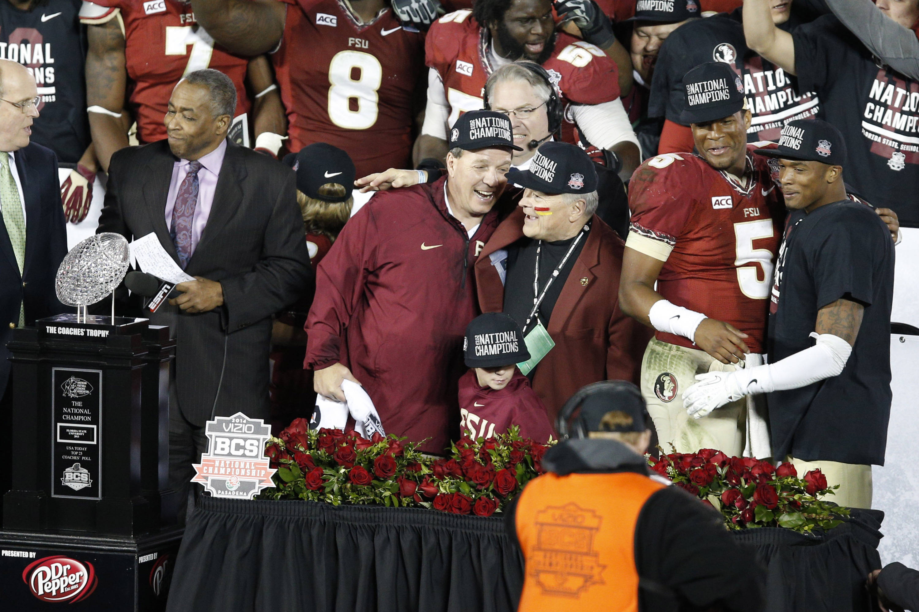 Jan 6, 2014; Pasadena, CA, USA; Florida State Seminoles head coach Jimbo Fisher (left), president Eric J. Barron (second from left), quarterback Jameis Winston (5), and defensive back P.J. Williams (far right) celebrate after defeating the Auburn Tigers 34-31 in the 2014 BCS National Championship game at the Rose Bowl.  Mandatory Credit: Kelvin Kuo-USA TODAY Sports