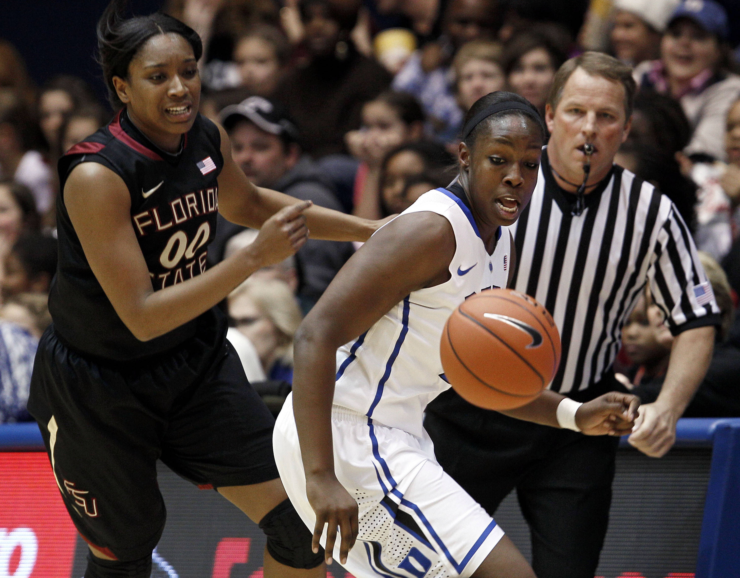 Florida State's Chasity Clayton (00) and Duke's Chelsea Gray chase a loose ball during the first half. (AP Photo/Gerry Broome)