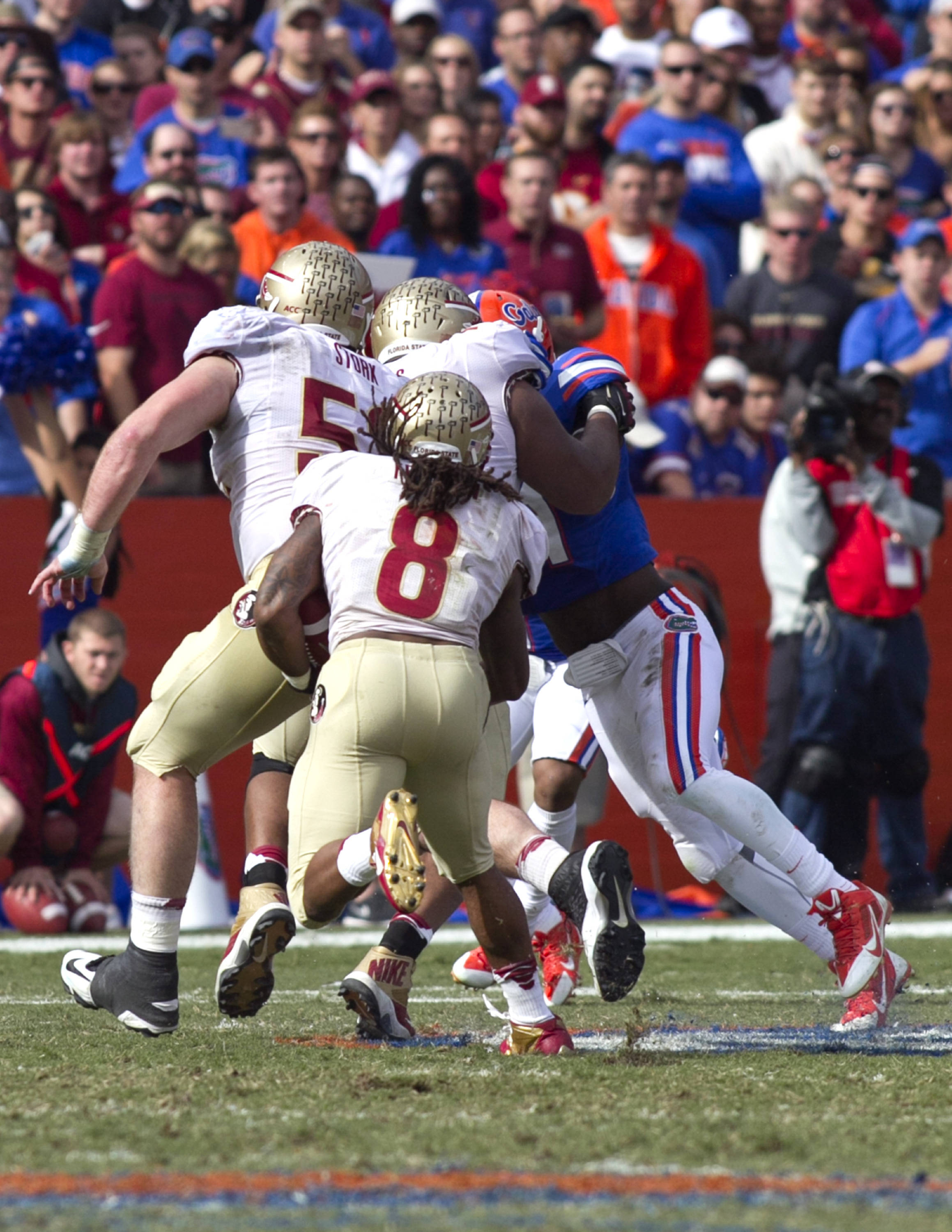 Devonta Freeman (8) following his blockers, FSU vs Florida, 11-30-13,  (Photo by Steve Musco)