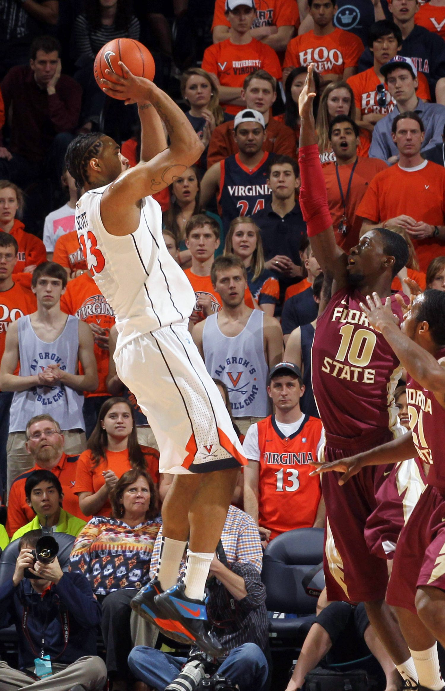 Virginia forward Mike Scott shoots over Florida State forward Okaro White during the first half. (AP Photo/Andrew Shurtleff)