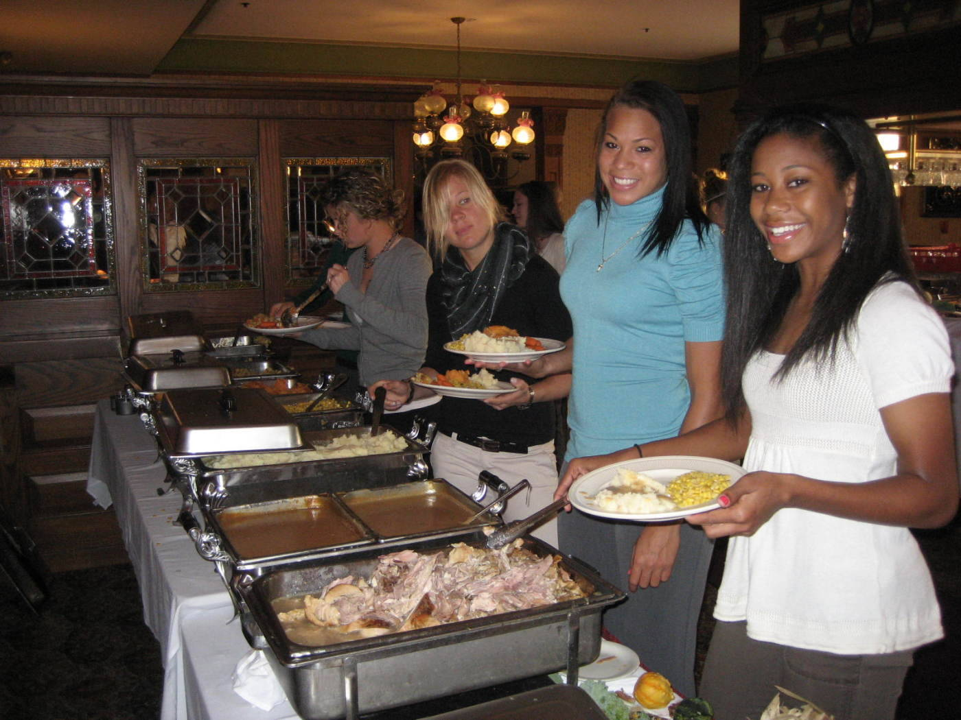(L to R): Katrin Schmidt, Toni Pressley and Casey Short loading up their plates.