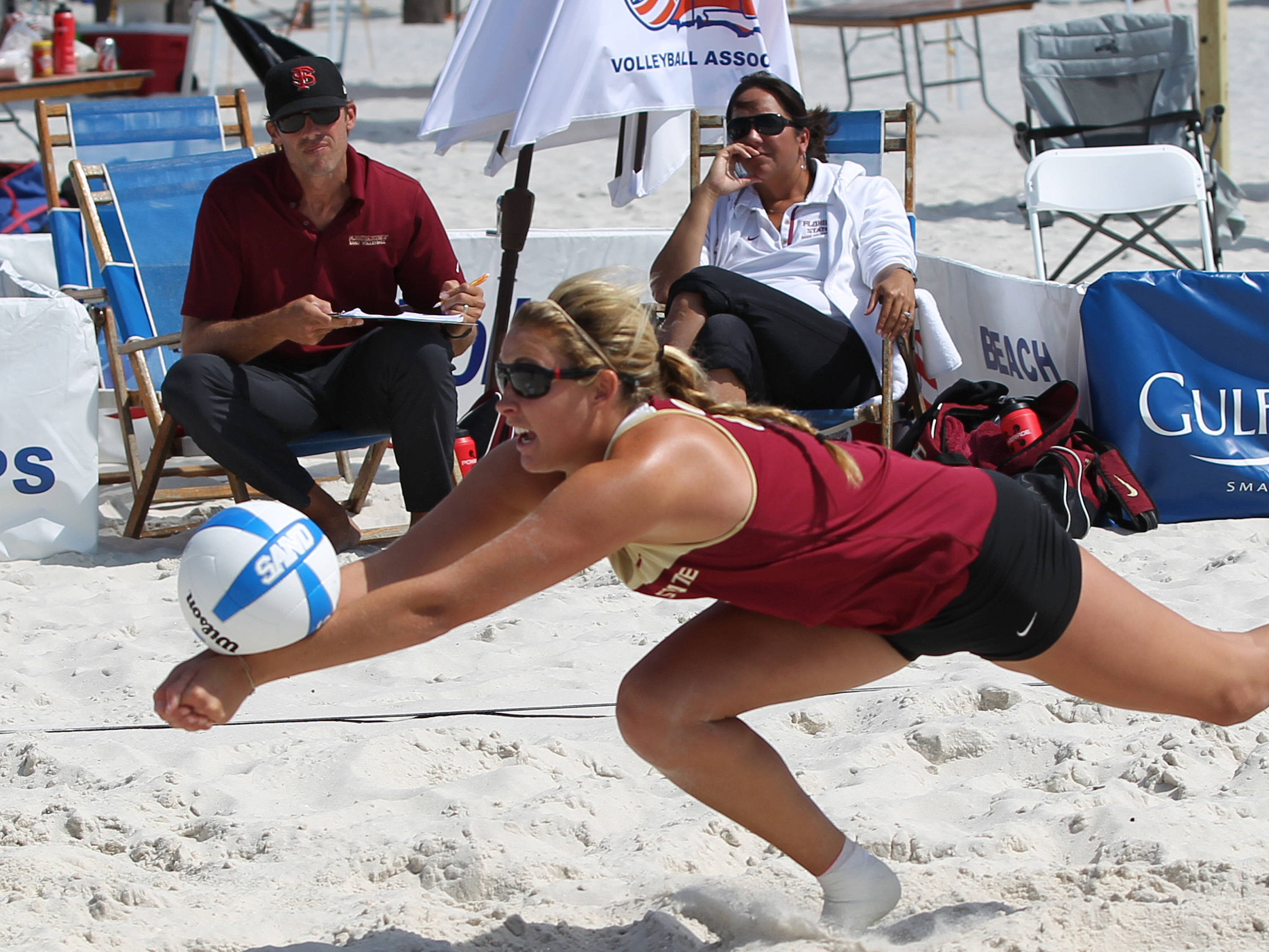 Coaches Danalee and Brian Corso watching Sarah Wickstrom, AVCA Collegiate Sand Volleyball National  Championships - Pairs,  Gulf Shores, Alabama, 05/05/13 . (Photo by Steve Musco)