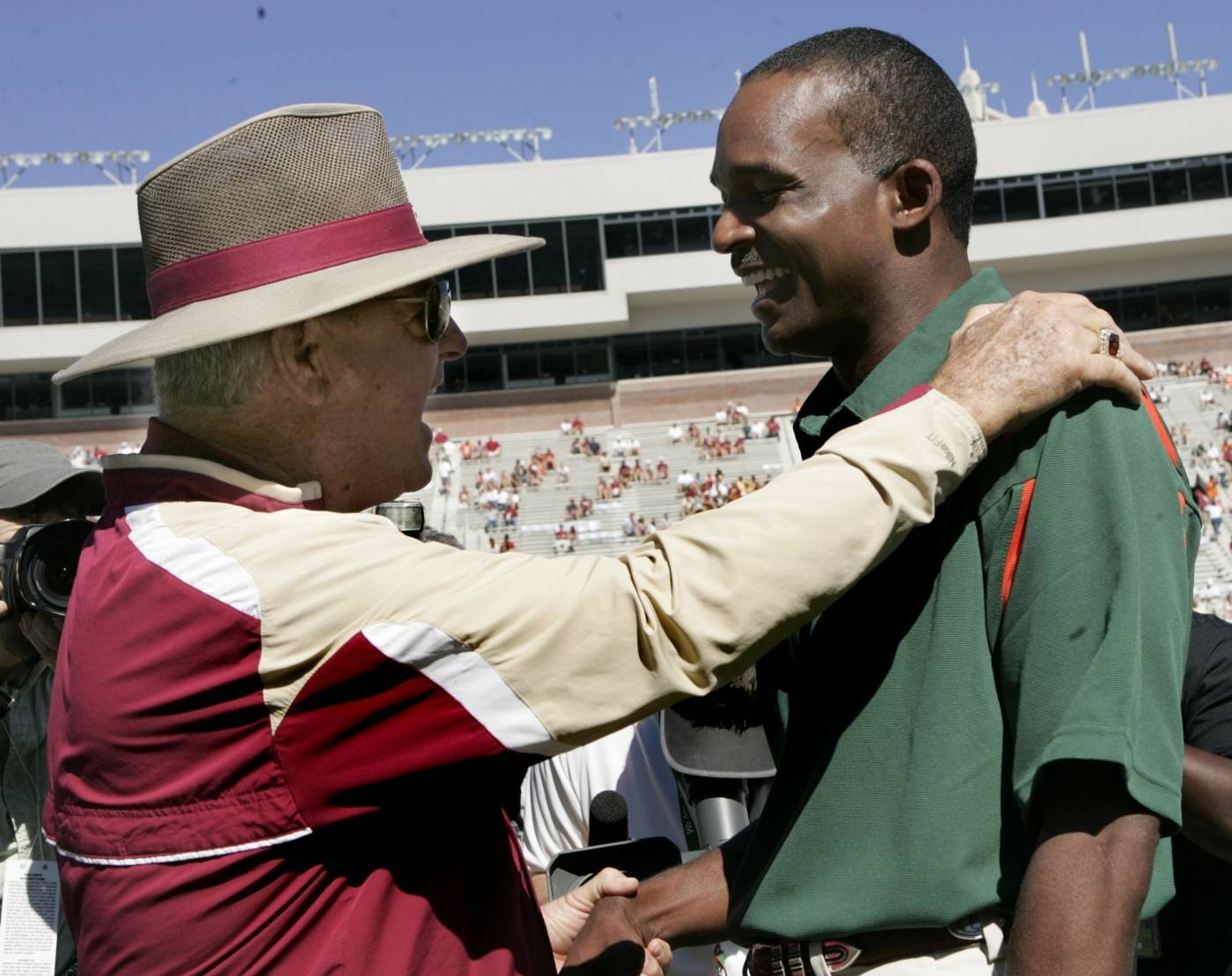 Florida State head coach Bobby Bowden, left, and Miami head coach Randy Shannon meet prior to the start of the game. (AP Photo/Steve Cannon)