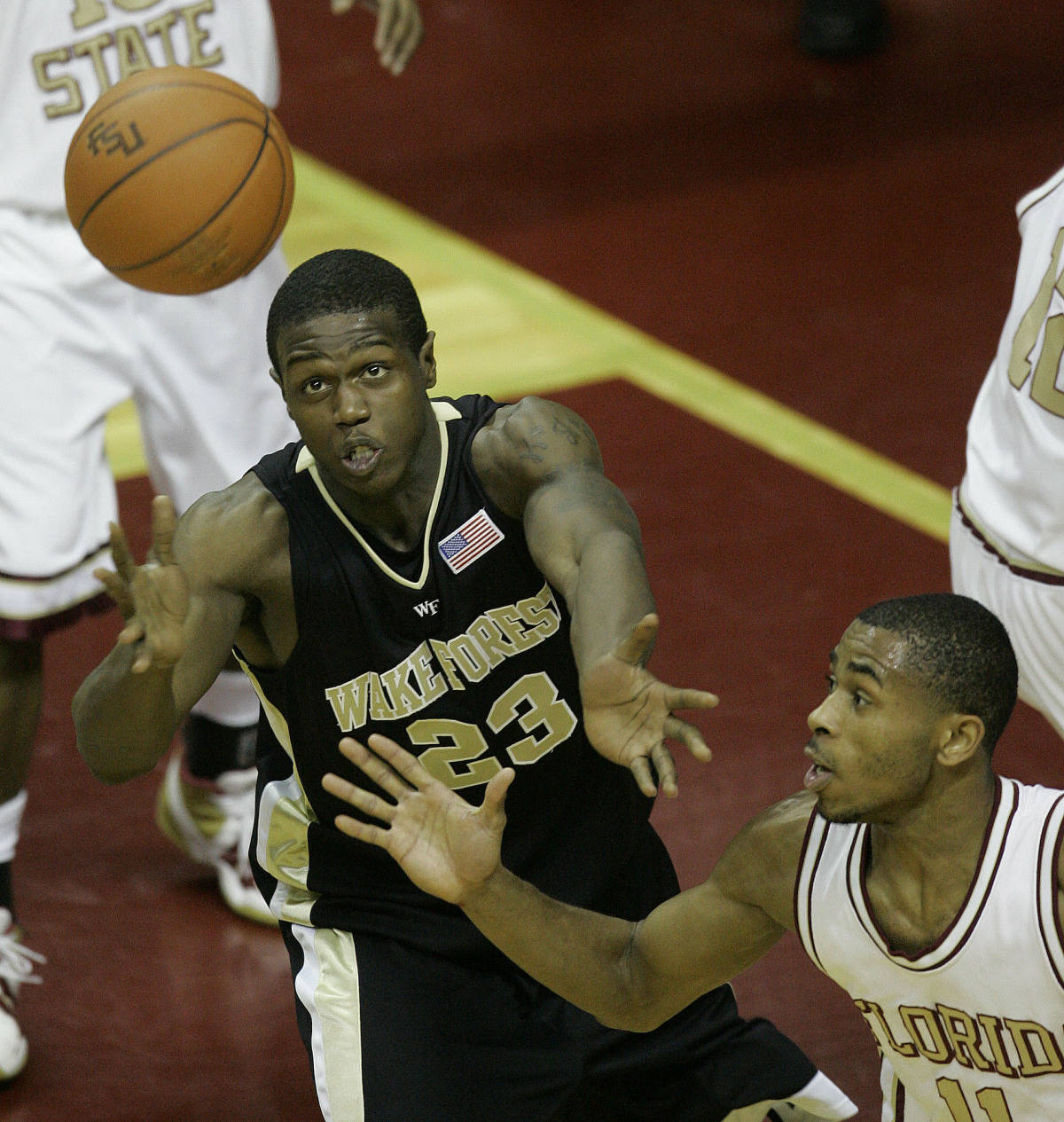 Wake Forest's Kevin Swinton, left, and Florida State's Jerel Allen, right, wait for a rebound in the first half during a college basketball game, Saturday, Jan. 27, 2007, in Tallahassee, Fla. (AP Photo/Phil Coale)