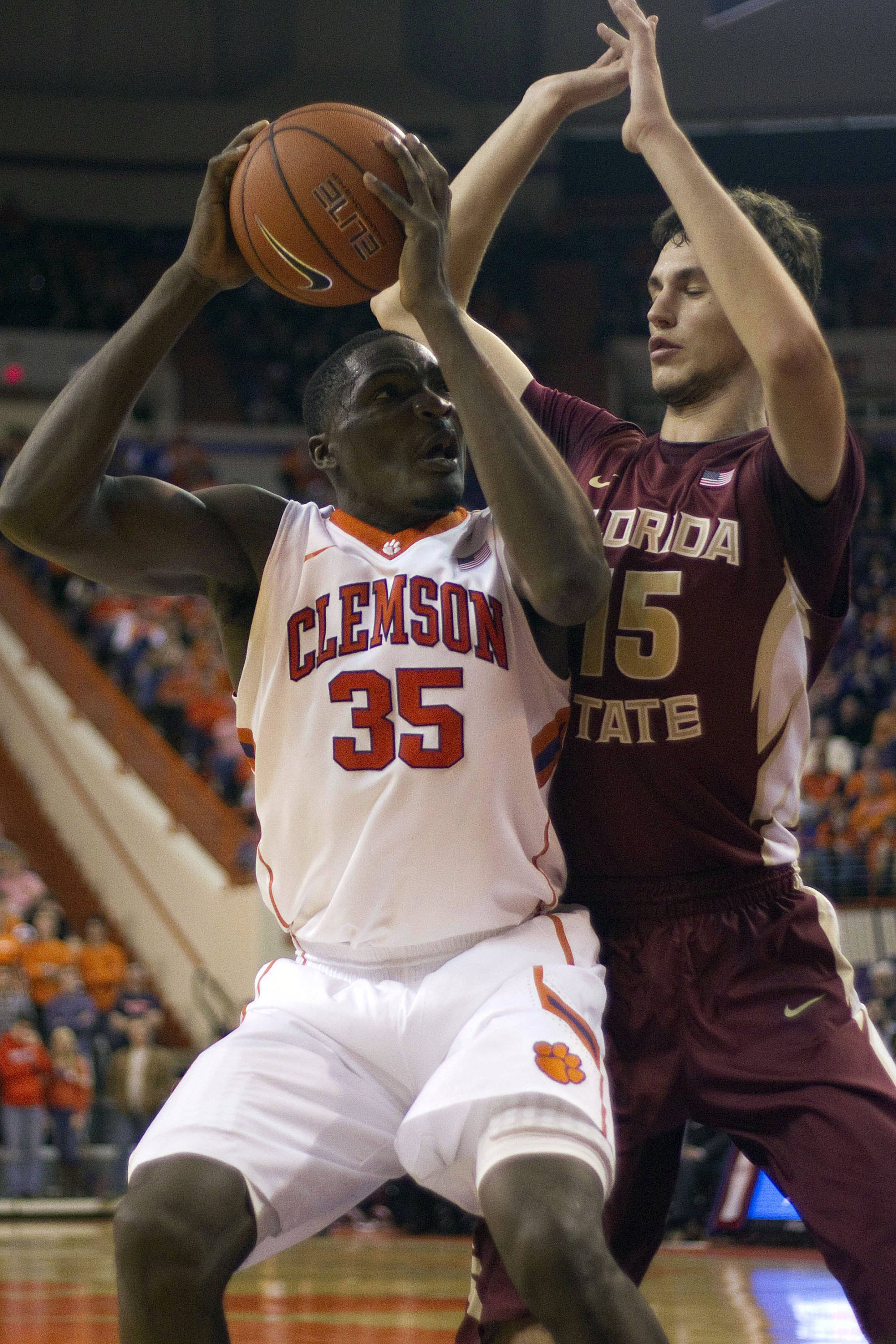 Jan 9, 2014; Clemson, SC, USA; Clemson Tigers center Landry Nnoko (35) drives to the basket while being defended by Florida State Seminoles center Boris Bojanovsky (15) during the second half at J.C. Littlejohn Coliseum. Seminoles won 56-41. Mandatory Credit: Joshua S. Kelly-USA TODAY Sports