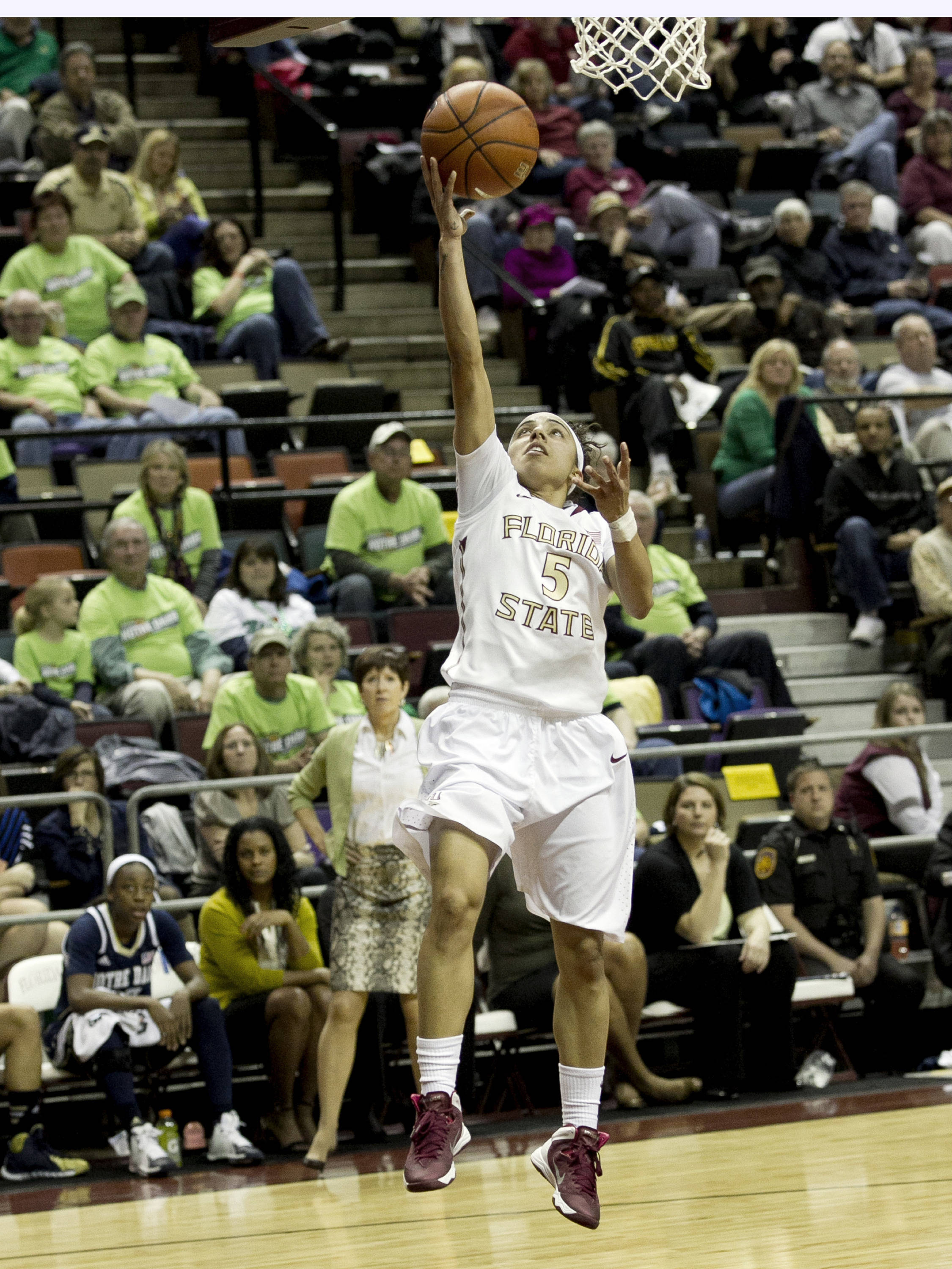 Cheetah Delgado (5), finishing her layup after a steal, FSU vs Notre Dame, 2-06-14, (Photo's by Steve Musco)