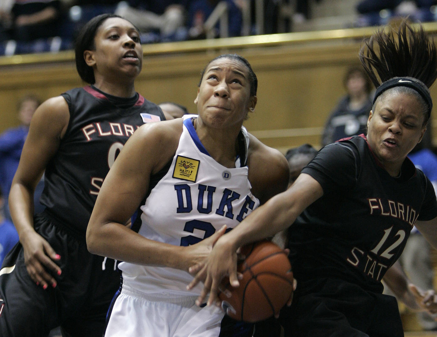 Duke's Joy Cheek drives to the basket as Florida State's Chasity Clayton and Courtney Ward defend.