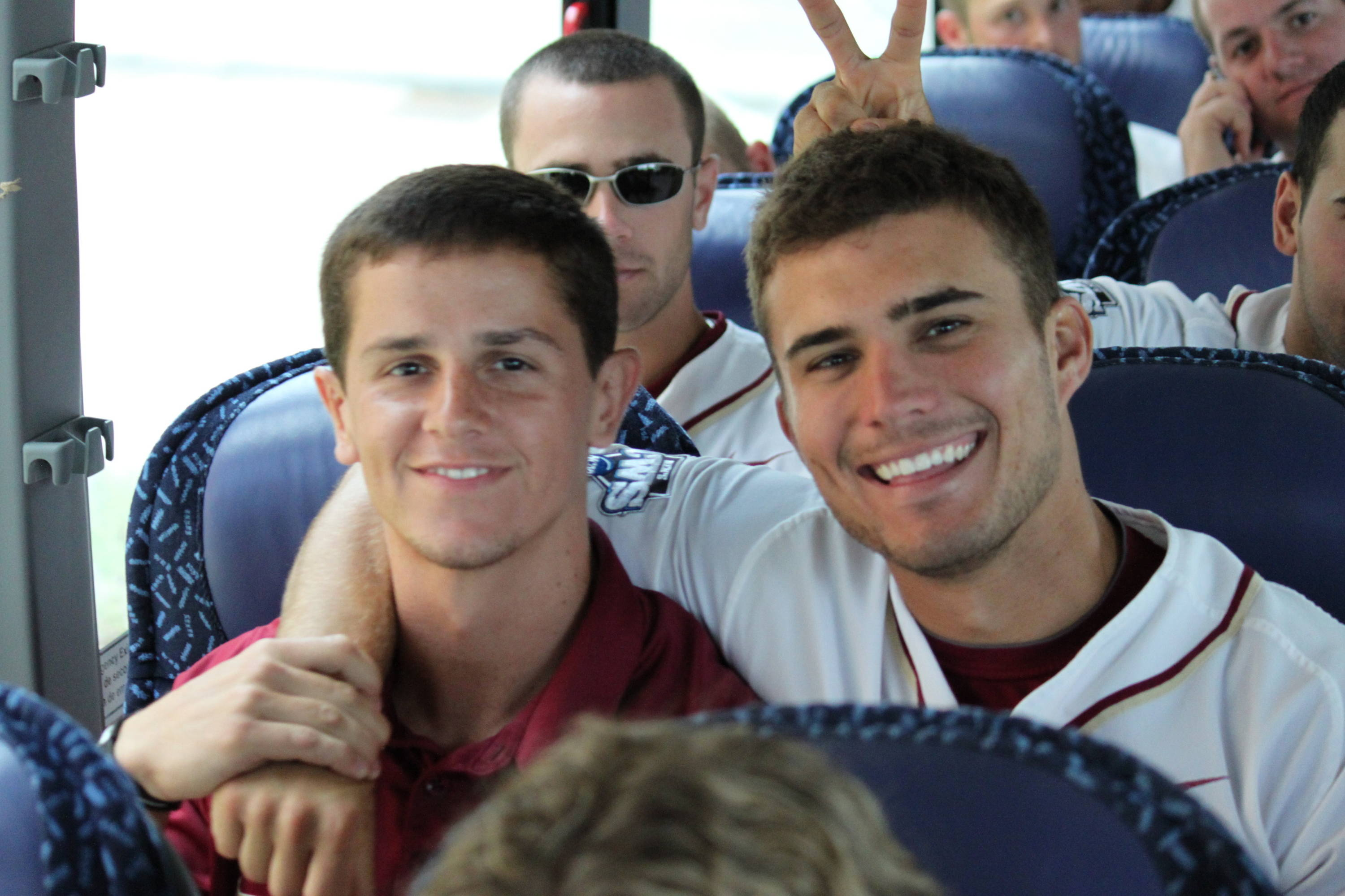 Derek Randolph and Robby Stahl on the bus ride back from the Children's Hospital