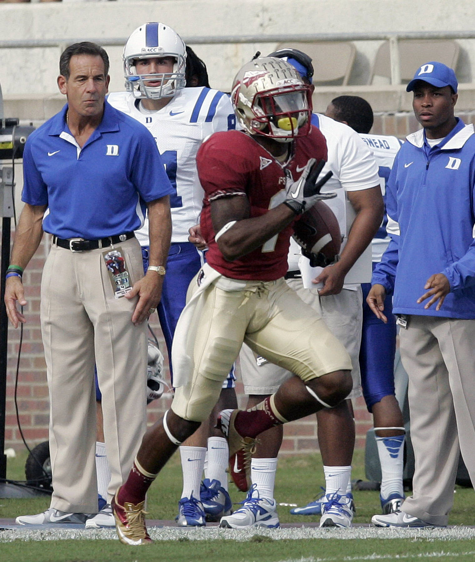 Duke's bench watches Florida State's Tyler Hunter run back a punt for a touchdown in the first quarter. (AP Photo/Steve Cannon)