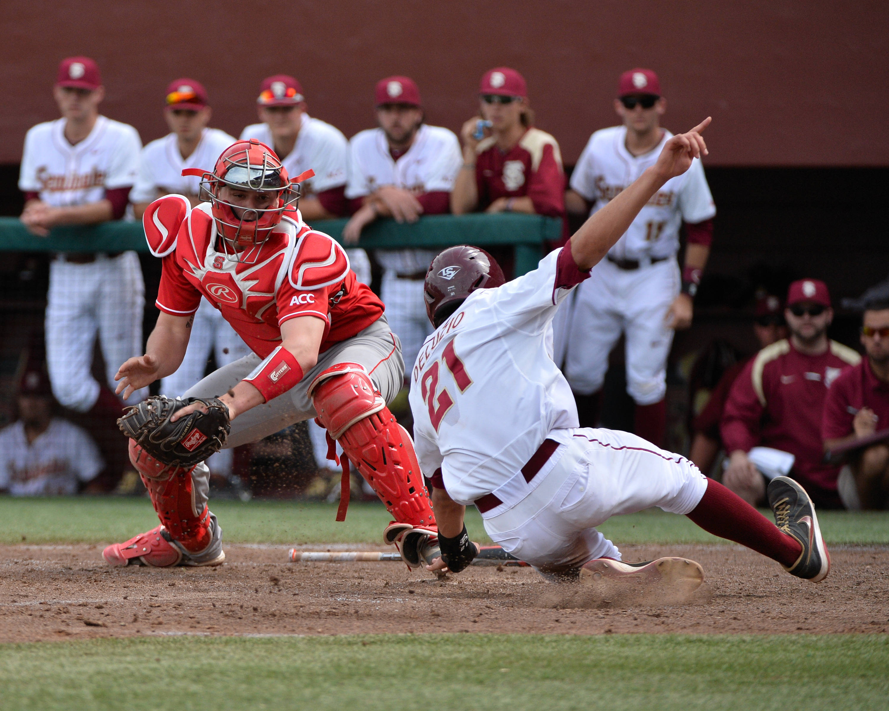 Ben DeLuzio slides ahead of the tag at home.