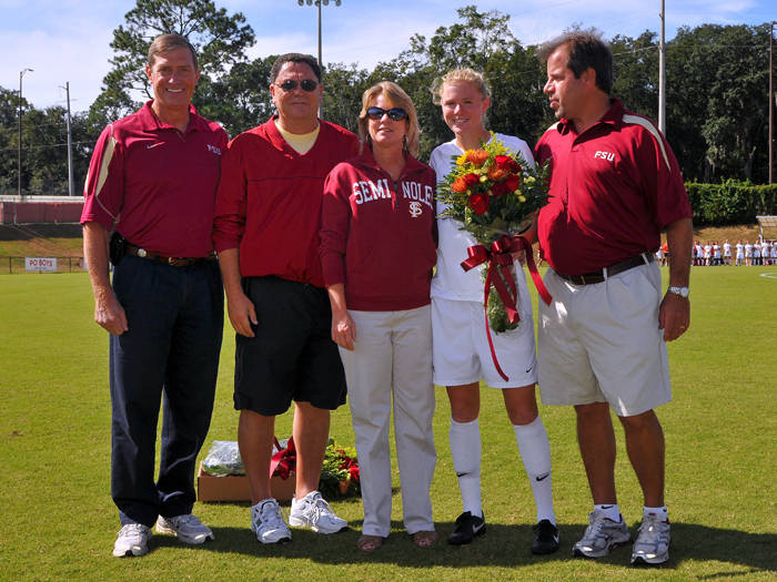 Senior Lauren Switzer with her parents, head coach Mark Krikorian and Athletics Director Randy Spetman