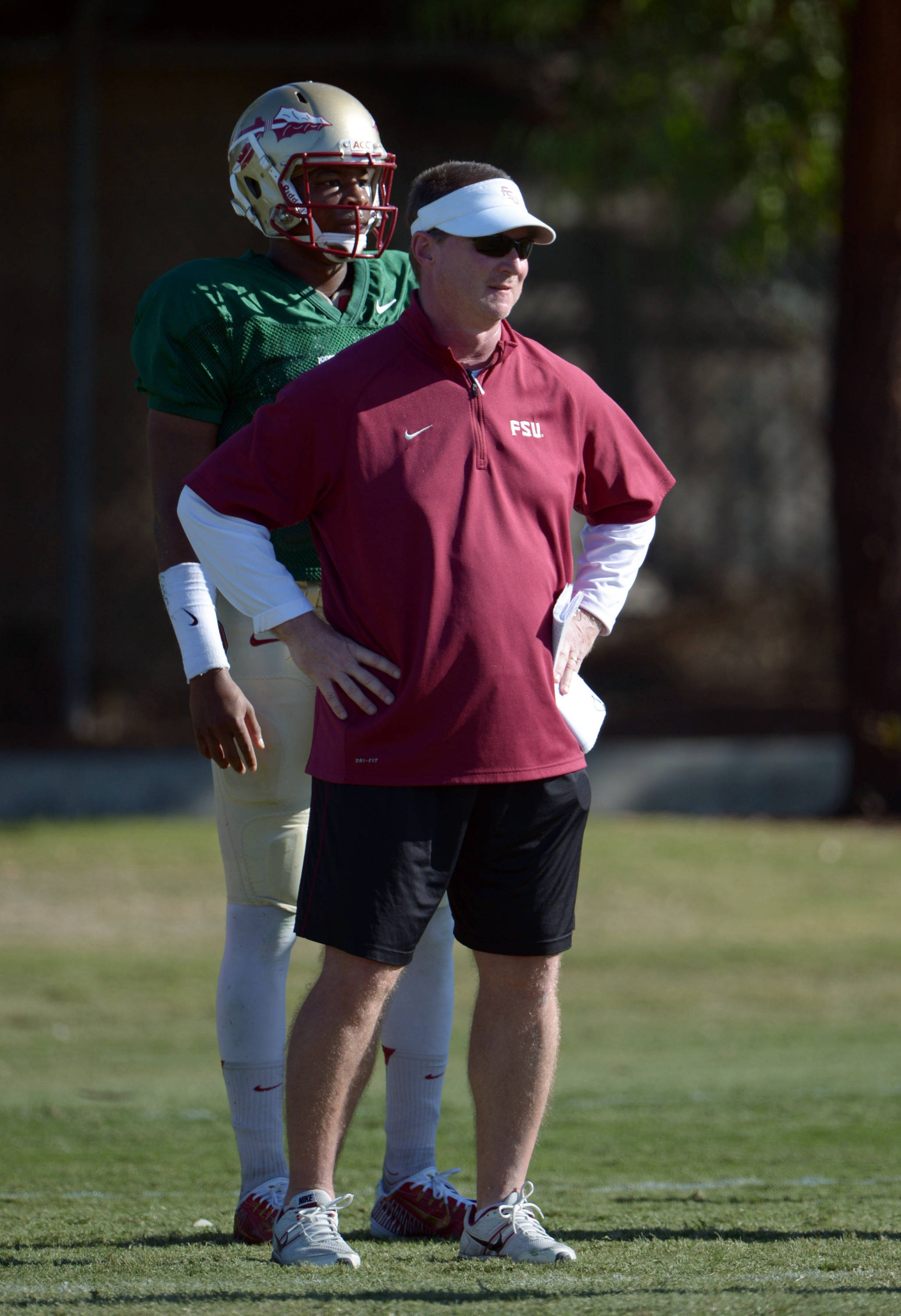 Florida State Seminoles quarterbacks coach Randy Sanders (right) and quarterback Jameis Winston at practice for the 2014 BCS National Championship. Mandatory Credit: Kirby Lee-USA TODAY Sports