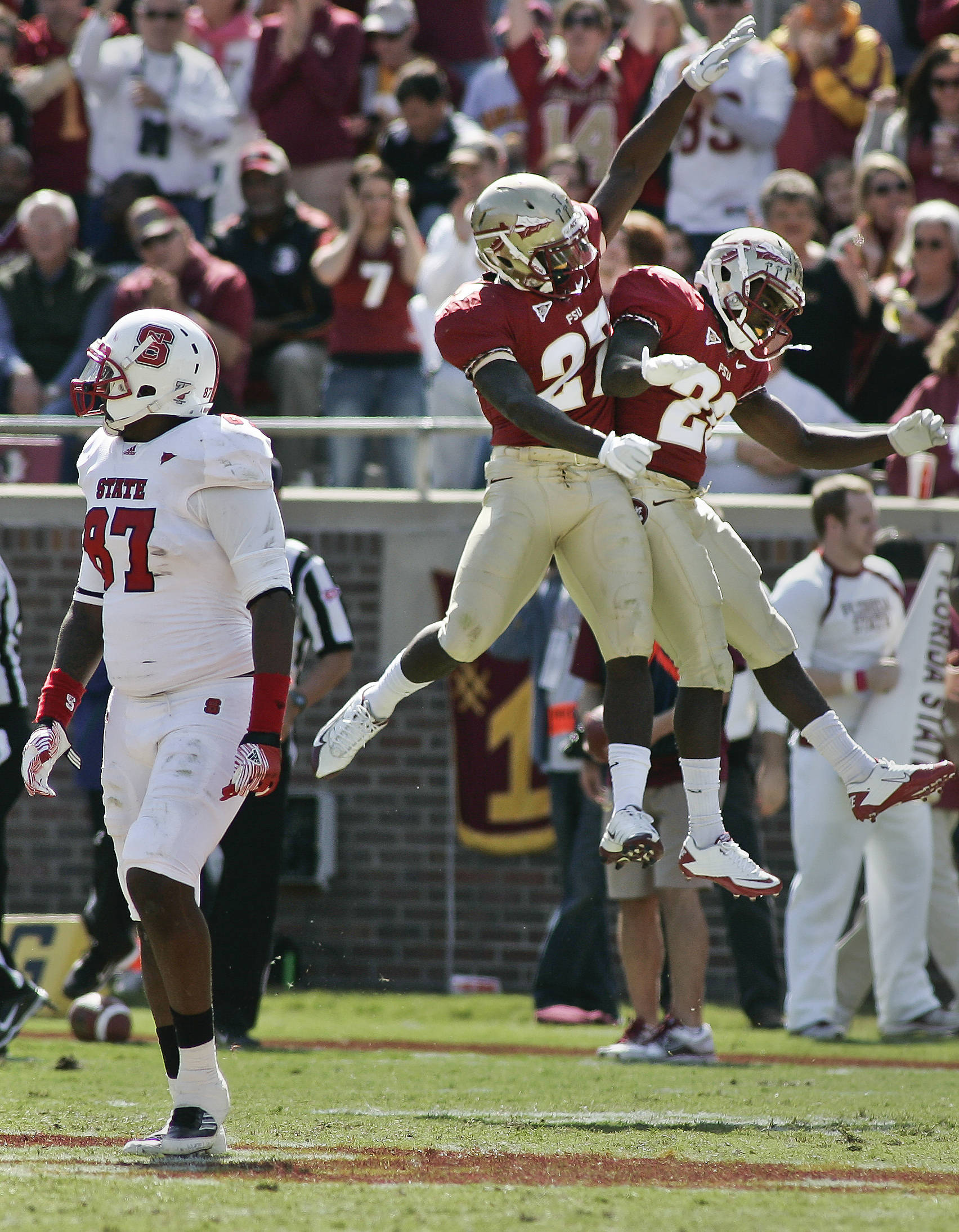 Florida State cornerback Xavier Rhodes (27) and safety Lamarcus Joyner (20) celebrate as North Carolina State tight end Mario Carter (87) walks away in the second quarter of an NCAA college football game at Doak Campbell Stadium in Tallahassee, Fla., Saturday, Oct. 29, 2011. (AP Photo/Phil Sears)