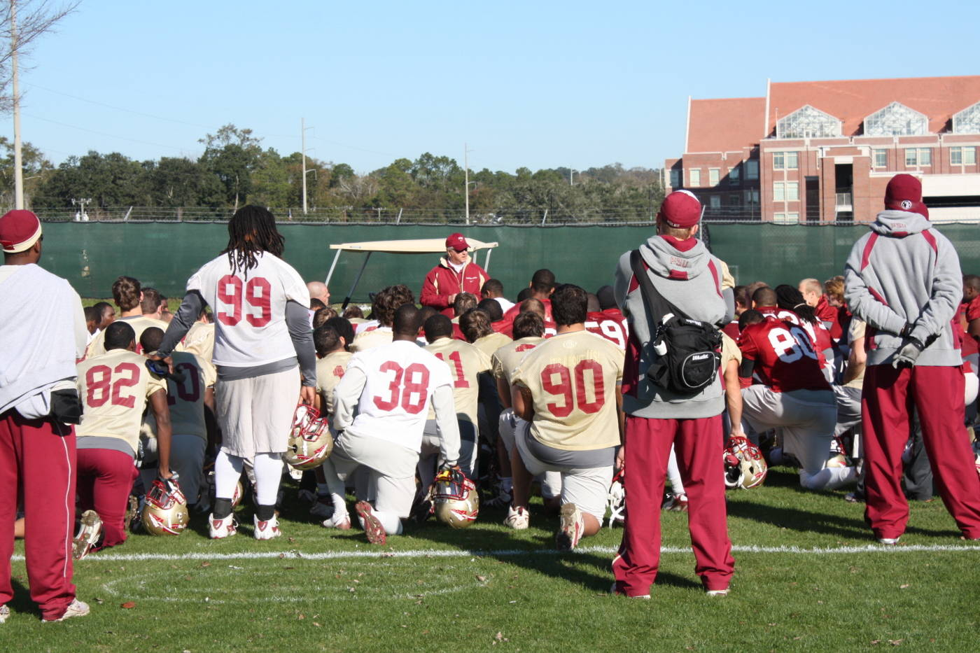 Coach Bowden addresses his team after practice