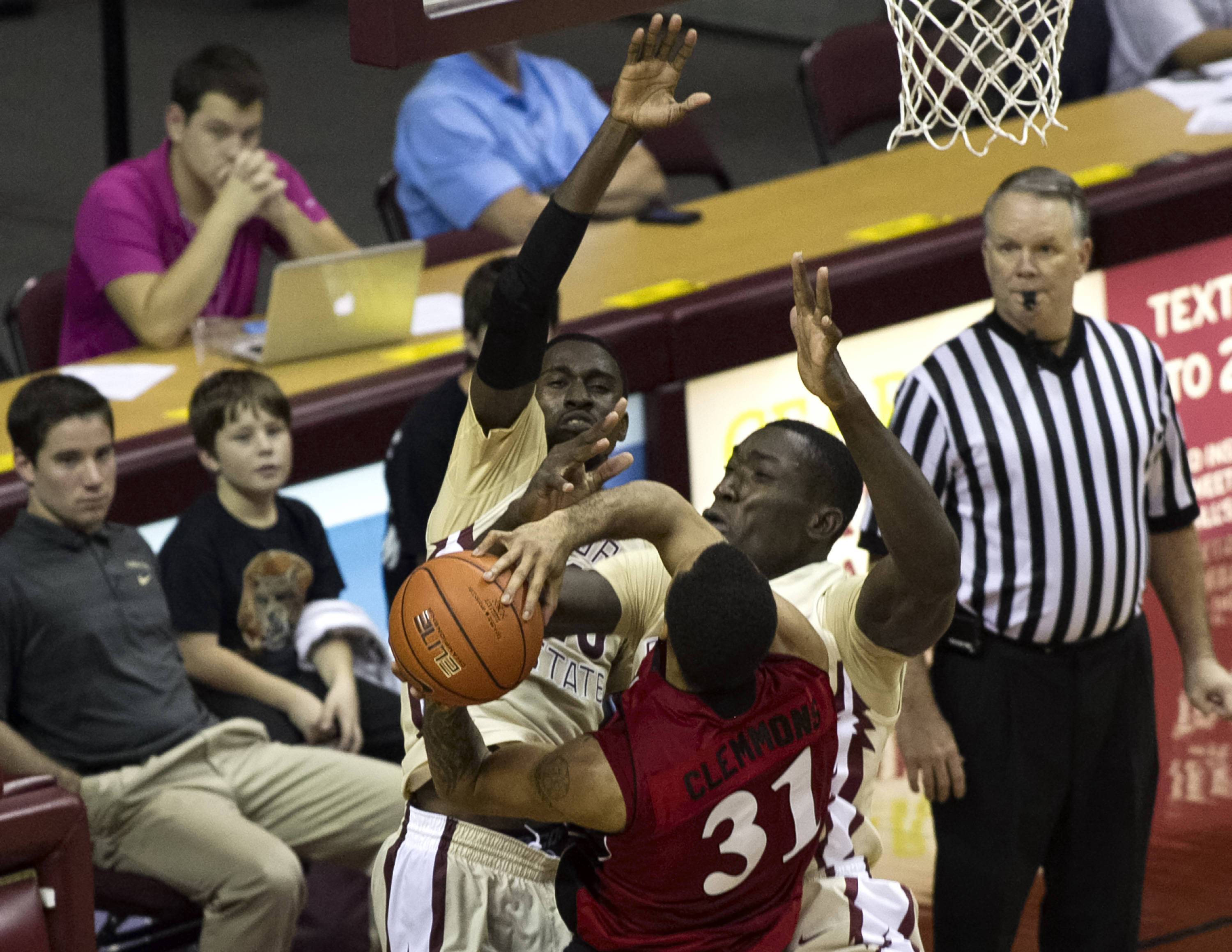 Michael Ojo (50) with a defensive effort, FSU vs Jacksonville State, 12-08-13,  (Photo by Steve Musco)