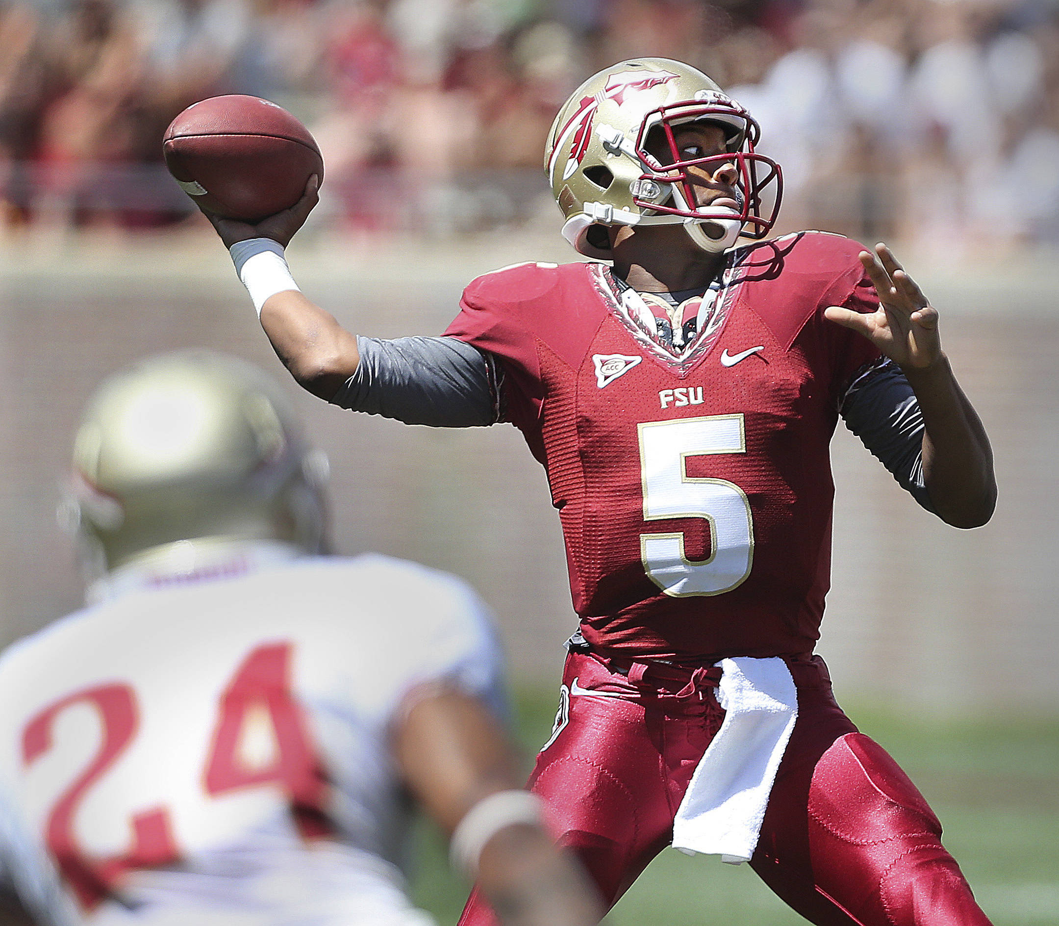 Redshirt freshman quarterback Jameis Winston threw for two scores and ran for another, but his Garnet team came up short during Saturday's Spring Football game inside of Doak Campbell Stadium on April 13, 2013. An estimated 25,000 people came out to get a first look at the Seminoles. (AP Photo/Tallahassee Democrat, Mike Ewen)