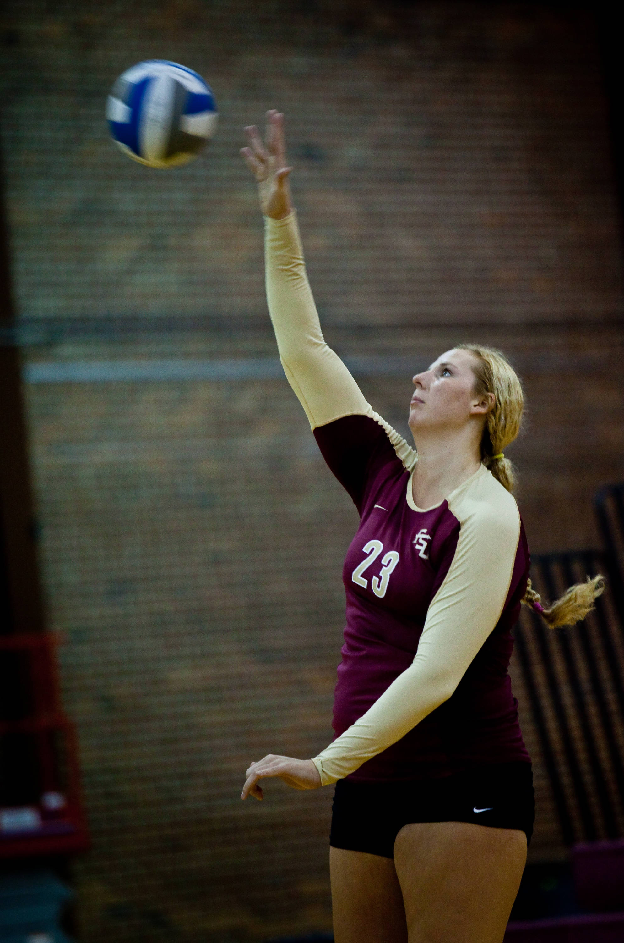 Elise Walch (23) records another serve.