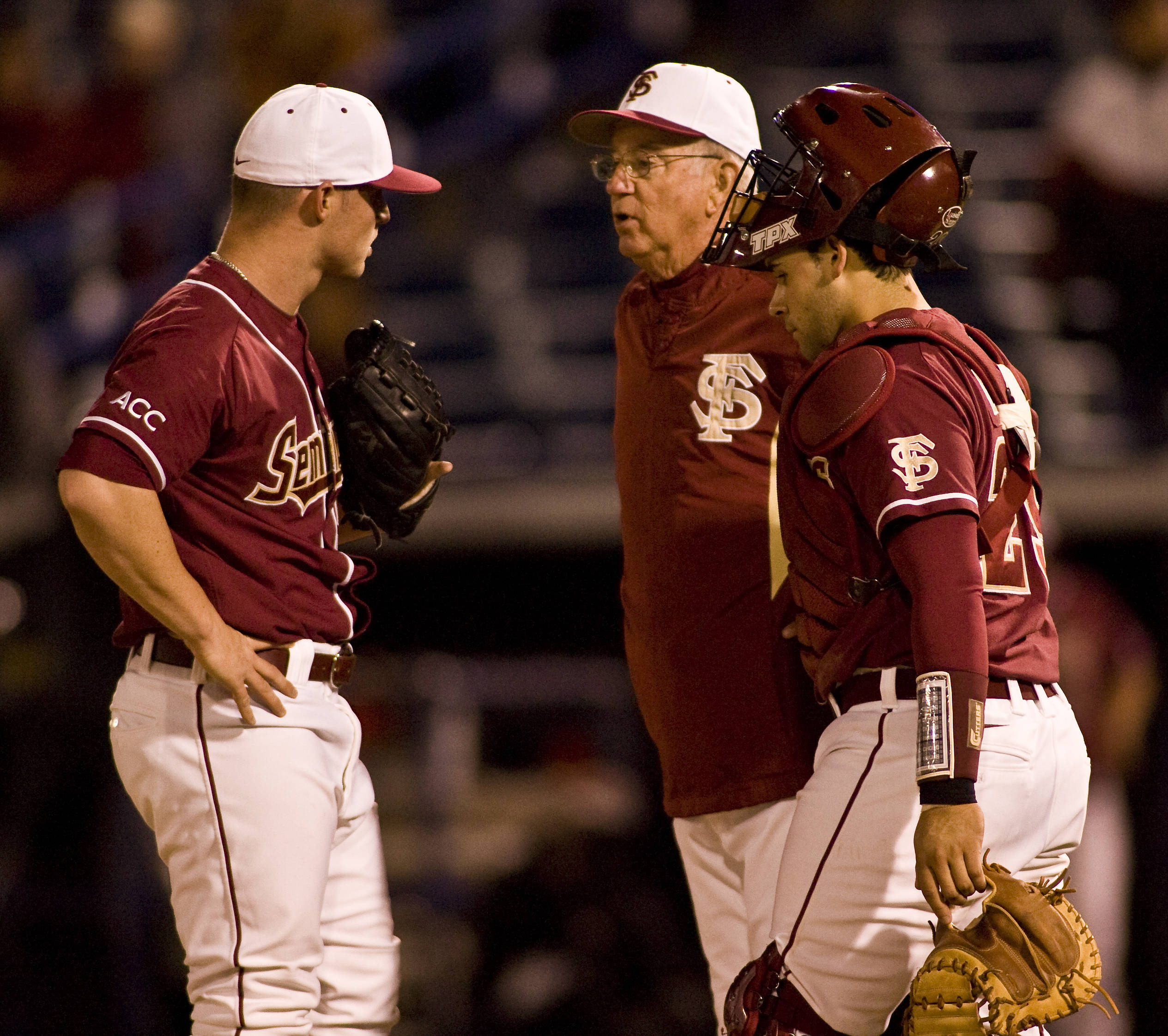 Andrew Durden (left) on the mound with head coach Mike Martin and catcher Rafael Lopez