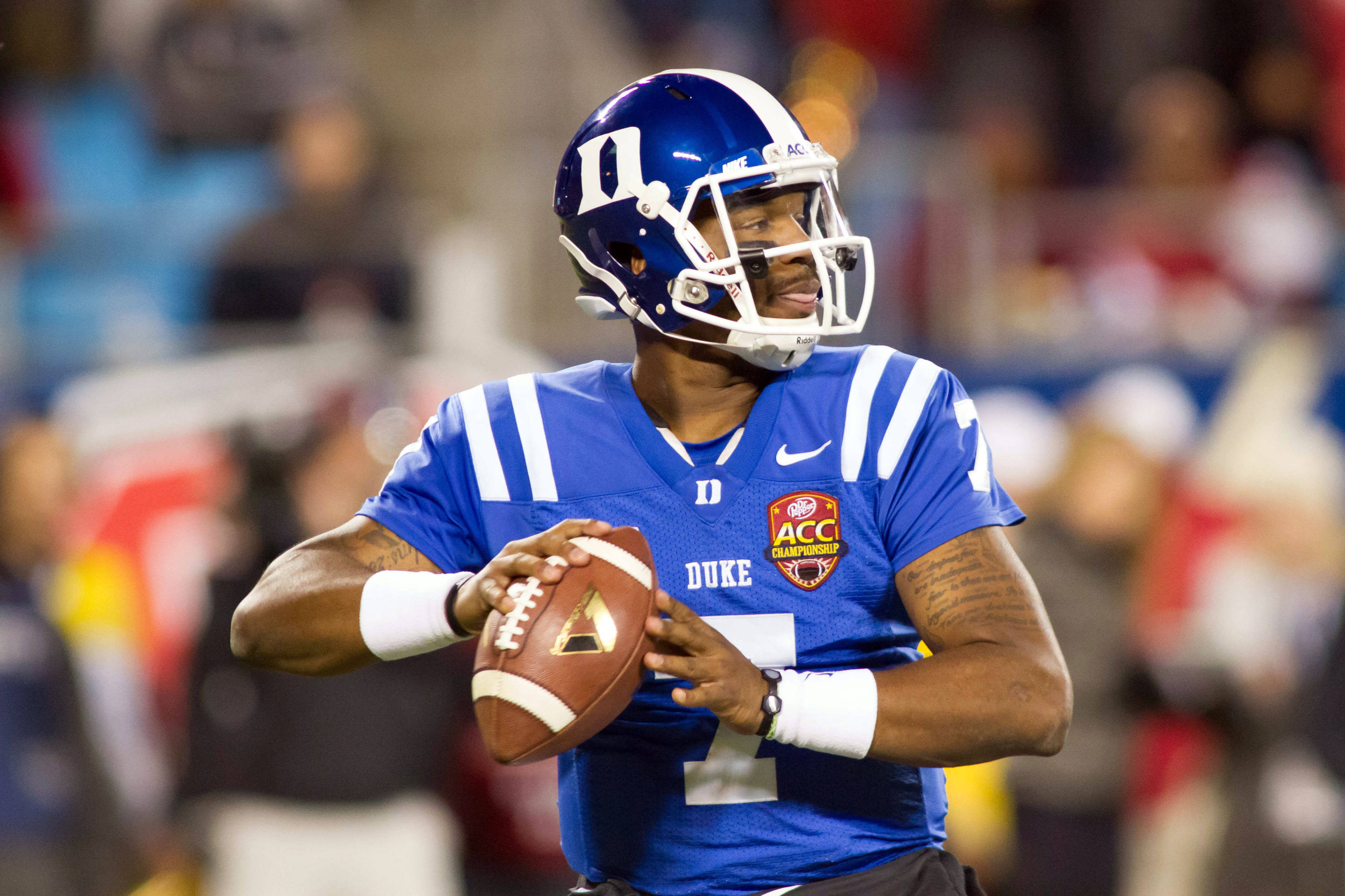Dec 7, 2013; Charlotte, NC, USA; Duke Blue Devils quarterback Anthony Boone (7) looks to pass the ball during the second quarter against the Florida State Seminoles at Bank of America Stadium. Mandatory Credit: Jeremy Brevard-USA TODAY Sports
