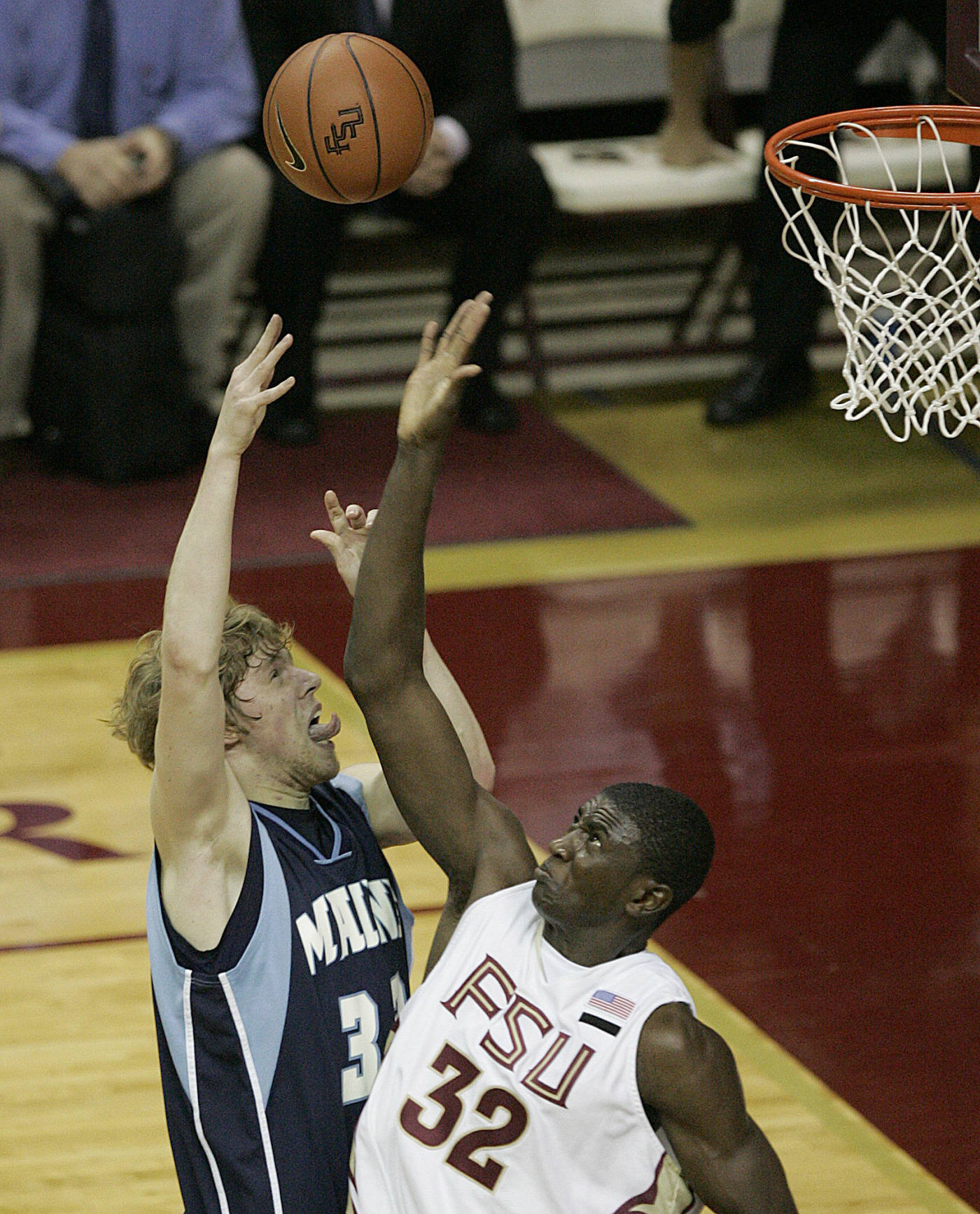 Maine's Jordan Cook tries to shoot over Florida State's Solomon Alabi in the first half.