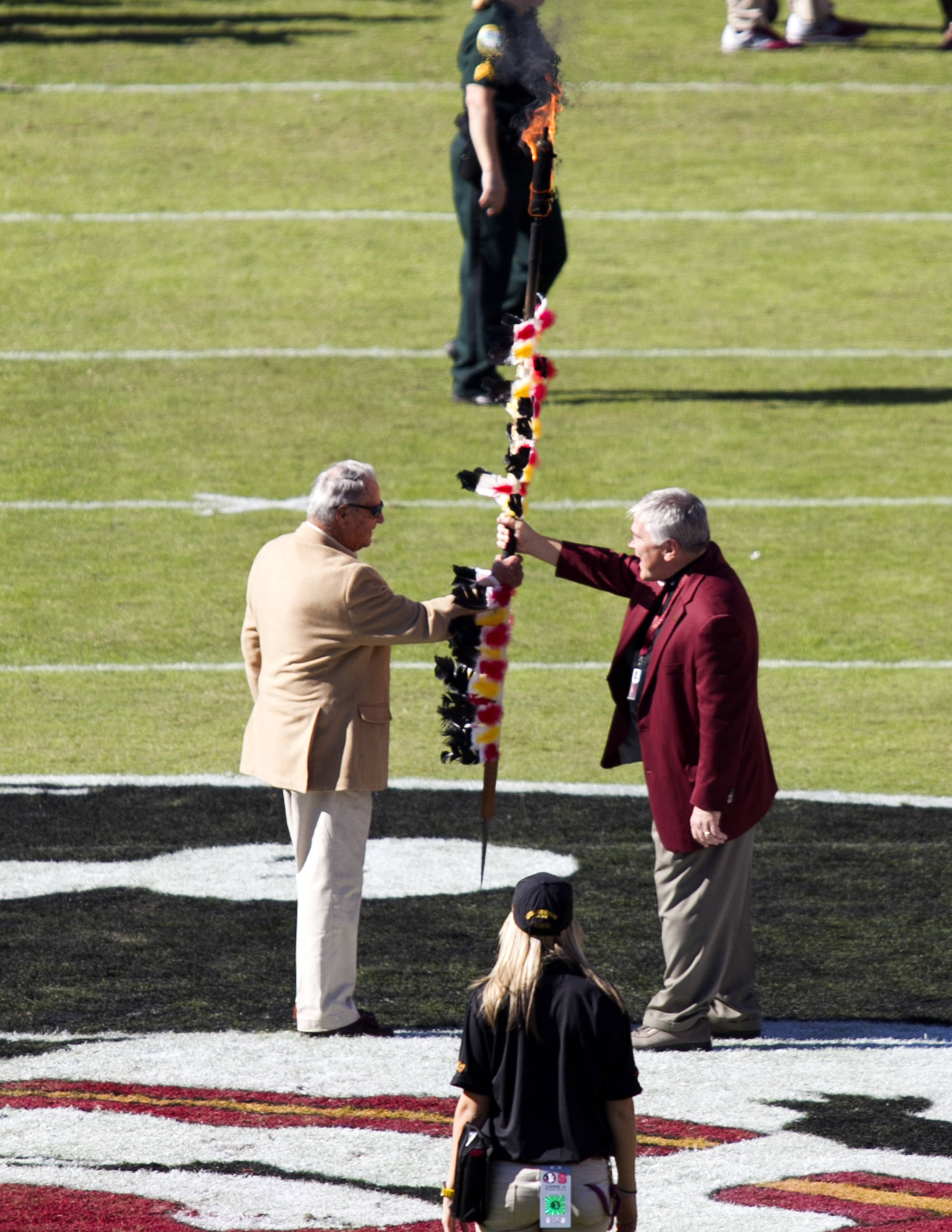 President Barron handing the spear to Coach Bowden, FSU vs NC State,  10-26-13, (Photo by Steve Musco)