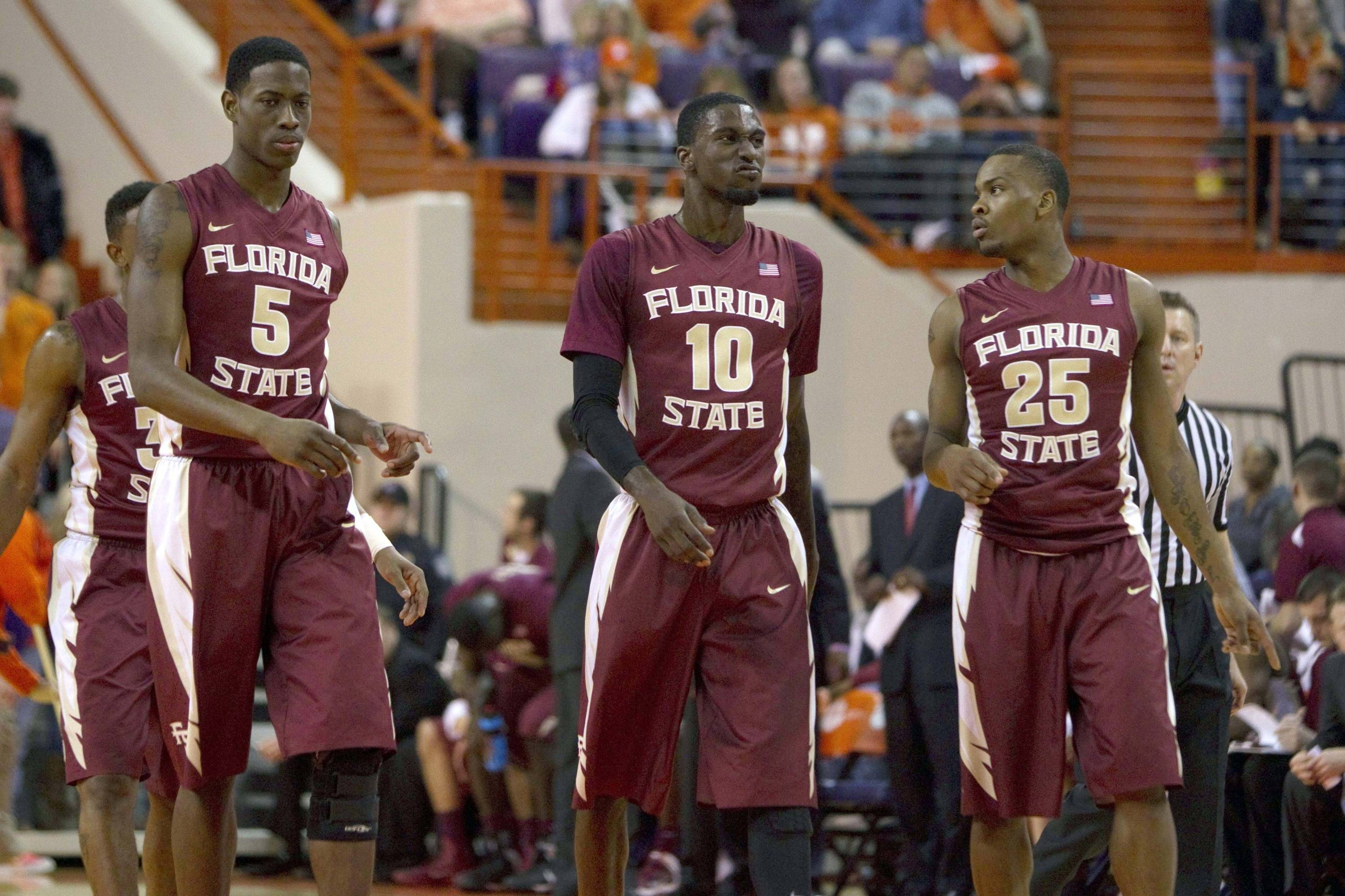 Jan 9, 2014; Clemson, SC, USA; Florida State Seminoles forward Jarquez Smith (5) forward Okaro White (10) and guard Aaron Thomas (25) during the first half against the Clemson Tigers at J.C. Littlejohn Coliseum. Mandatory Credit: Joshua S. Kelly-USA TODAY Sports