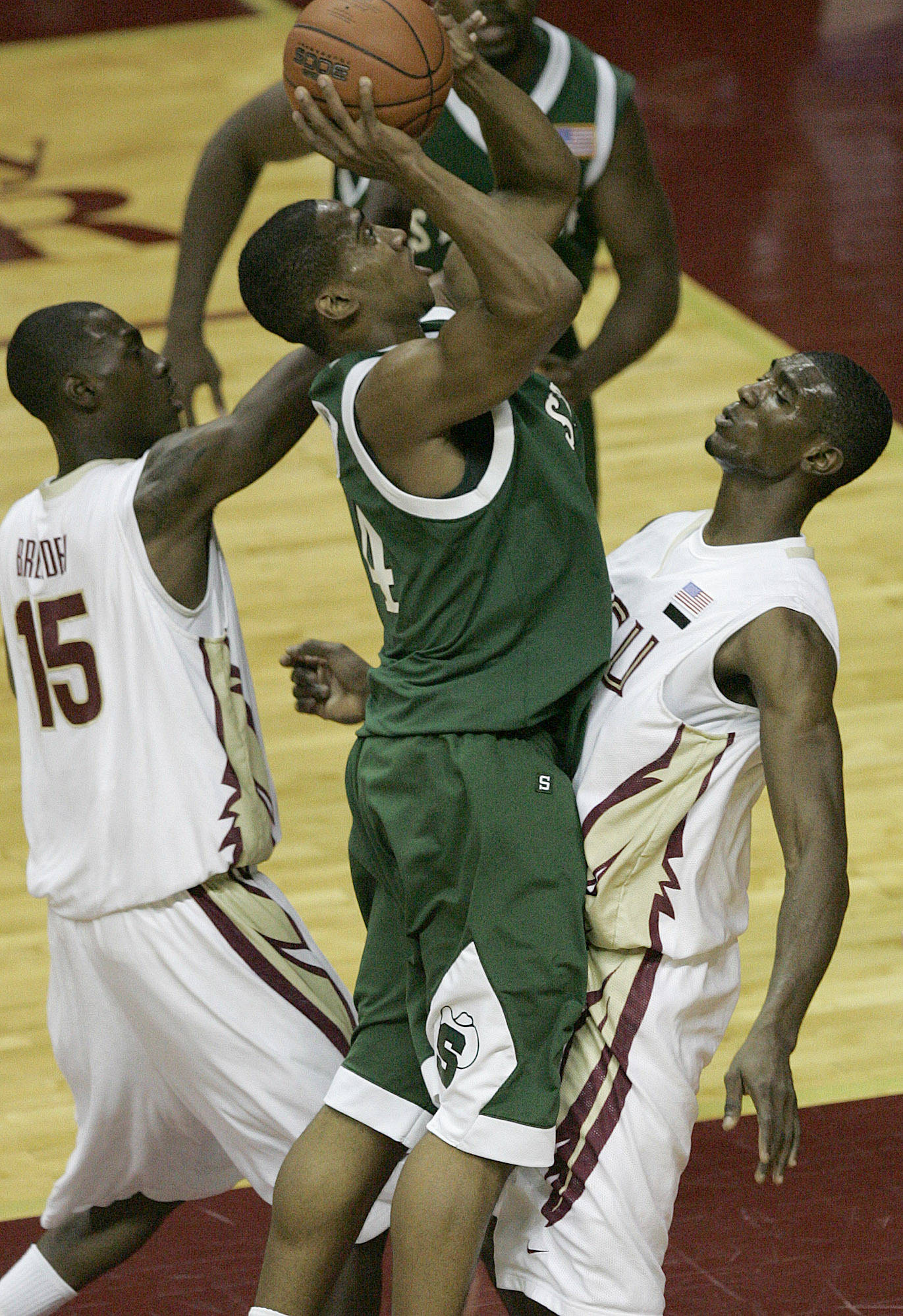 Florida State's Uche Echefu tries to draw a charge from Stetson's Garfield Blair in the first half of a college basketball game on Friday Nov. 30, 2007 in Tallahassee, Fla. (AP Photo/Steve Cannon)