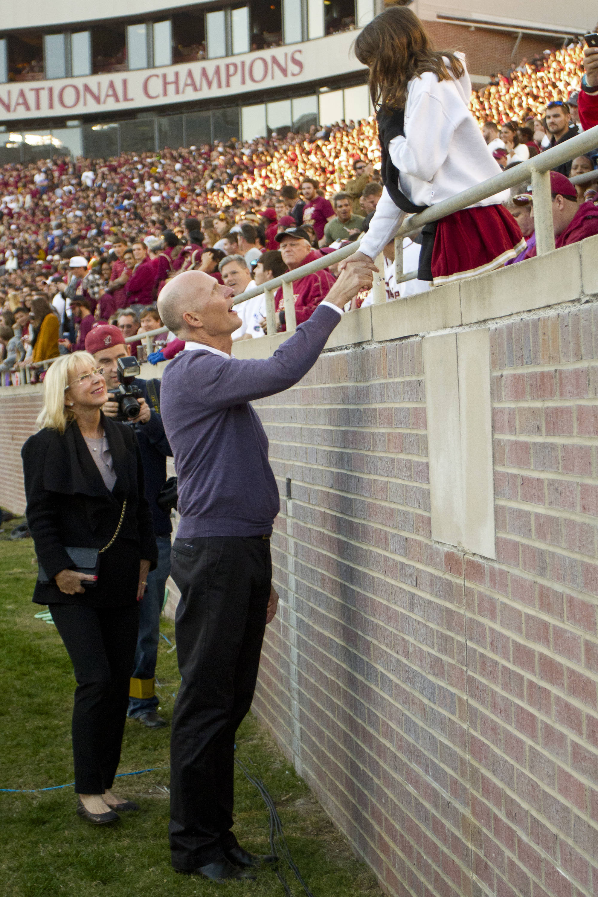 Florida's governor Rick Scott greets a fan during FSU Football's game against UF on Saturday, November 24, 2012 in Tallahassee, Fla.