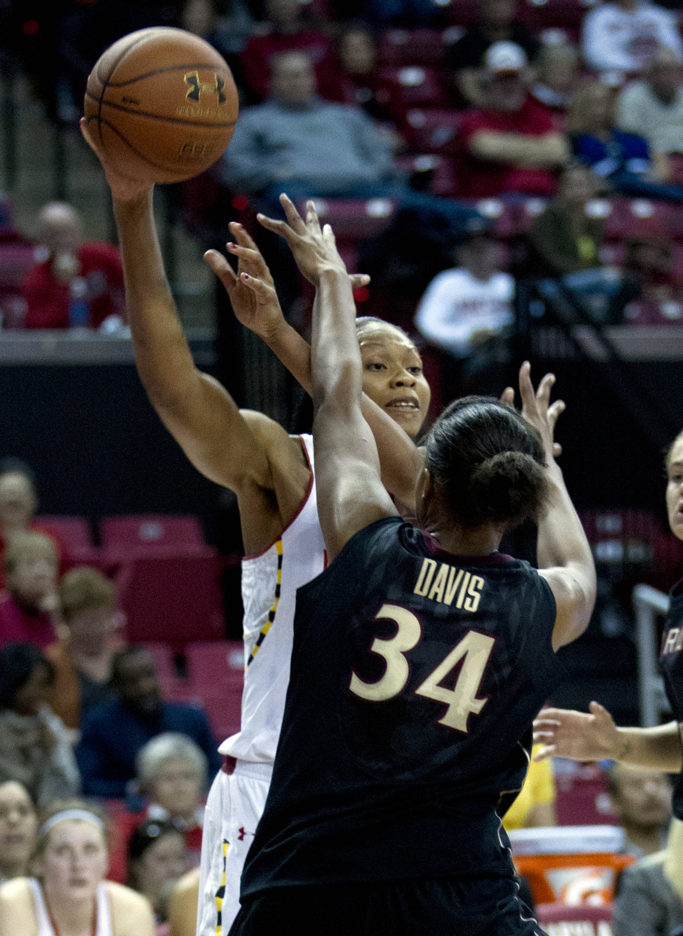 Maryland's Alicia DeVaughn, top, passes the ball against Florida State's Chelsea Davis (34) who blocks during the second half. (AP Photo/Jose Luis Magana)