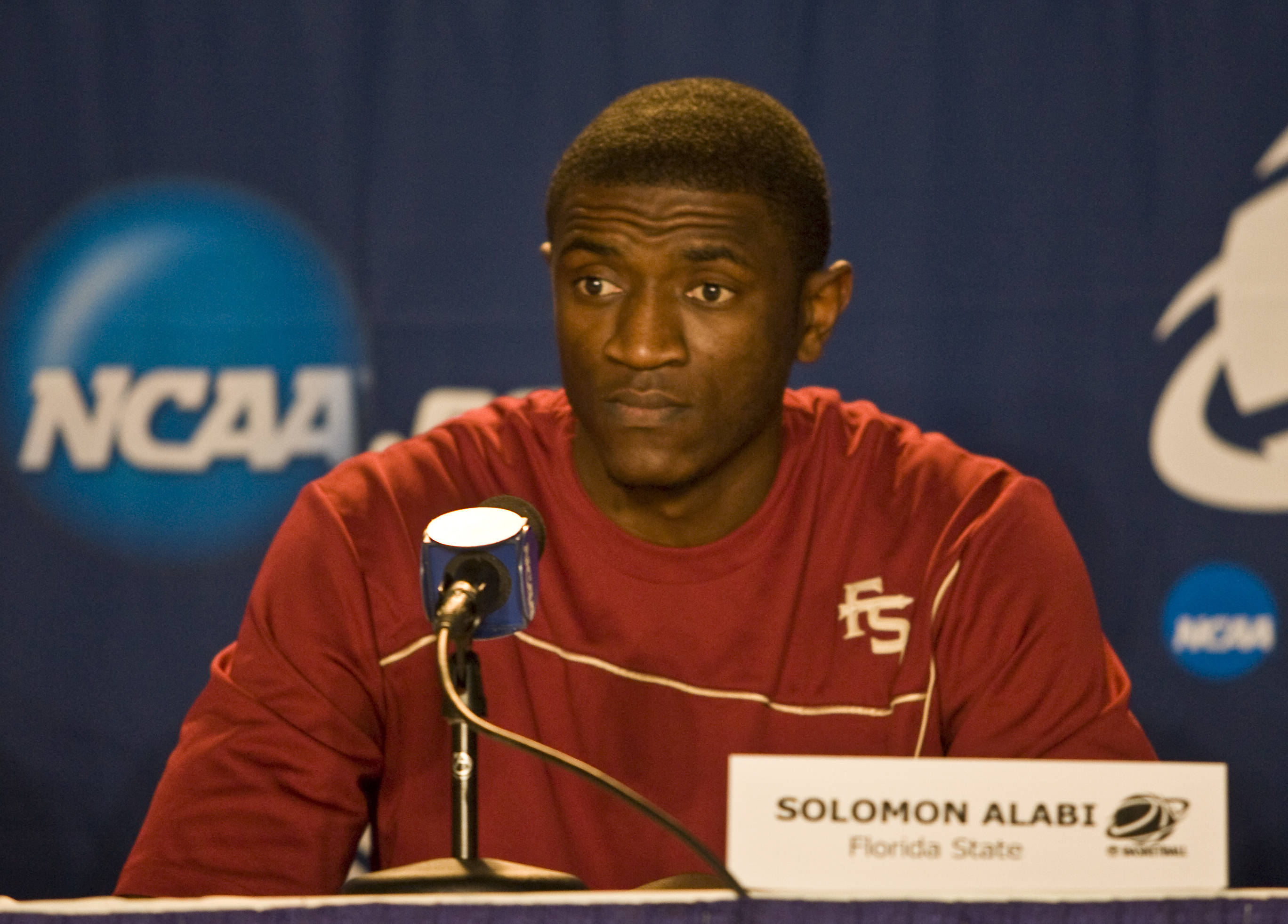 Sophomore Solomon Alabi talks to the media during the NCAA press conference.