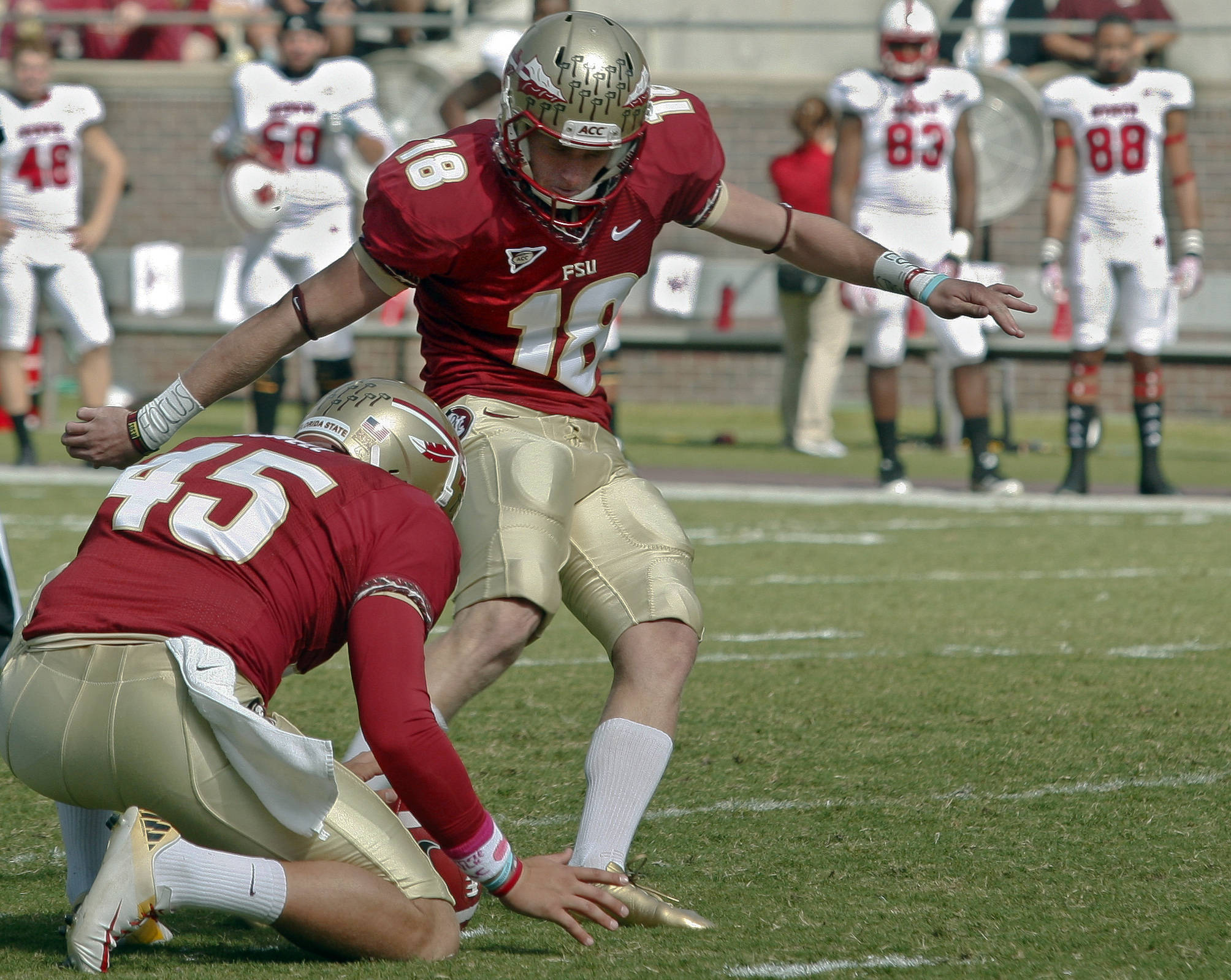 Florida State's Shawn Powell (45) holds the ball as kicker Dustin Hopkins (18) kicks a 43-yard field goal in the first quarter against North Carolina State. (AP Photo/Phil Sears)