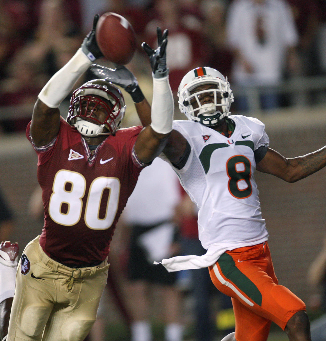 Florida State's Jarmon Fortson tries to make a catch as Miami's DeMarcus Van Dyke, right, defends during the first quarter of an NCAA college football game Monday, Sept. 7, 2009, in Tallahassee, Fla. (AP Photo/Phil Coale)