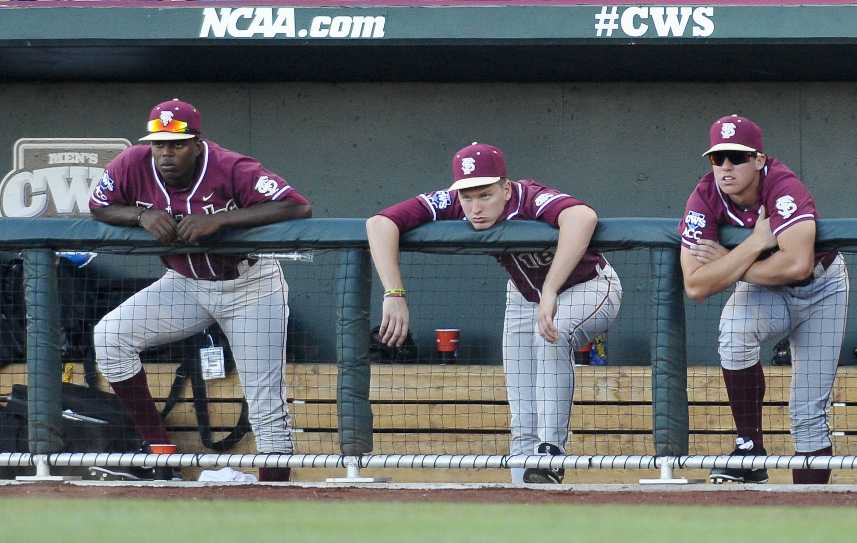 Florida State players, including Seth Miller, center, follow the eighth inning against Arizona. (AP Photo/Eric Francis)