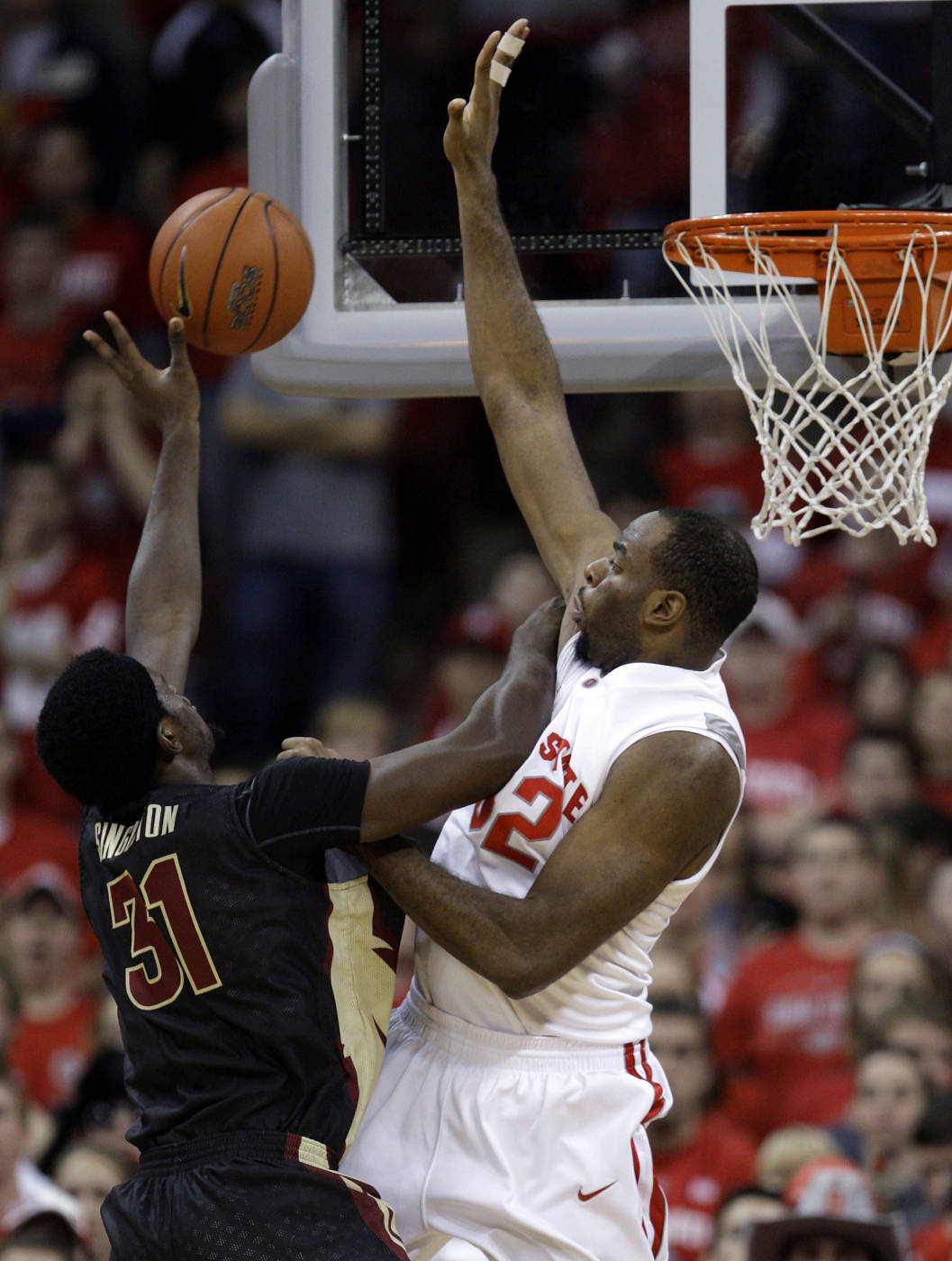 Florida State's Chris Singleton, left, tries to shoot over Ohio State's Dallas Lauderdale during the second half.