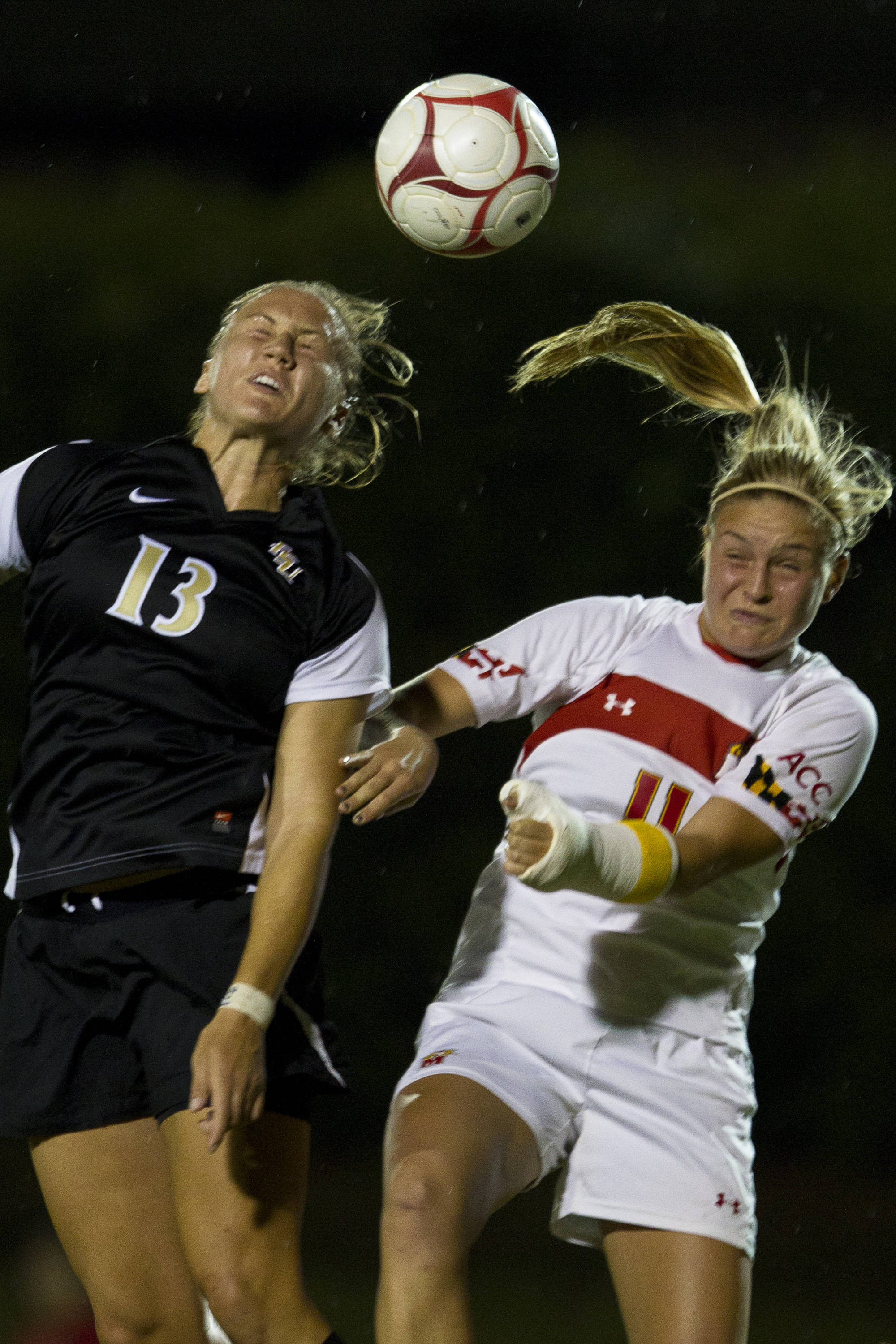 Kristin Grubka (13) attempts to head the ball into the goal  during the game against Maryland on October 13, 2011.