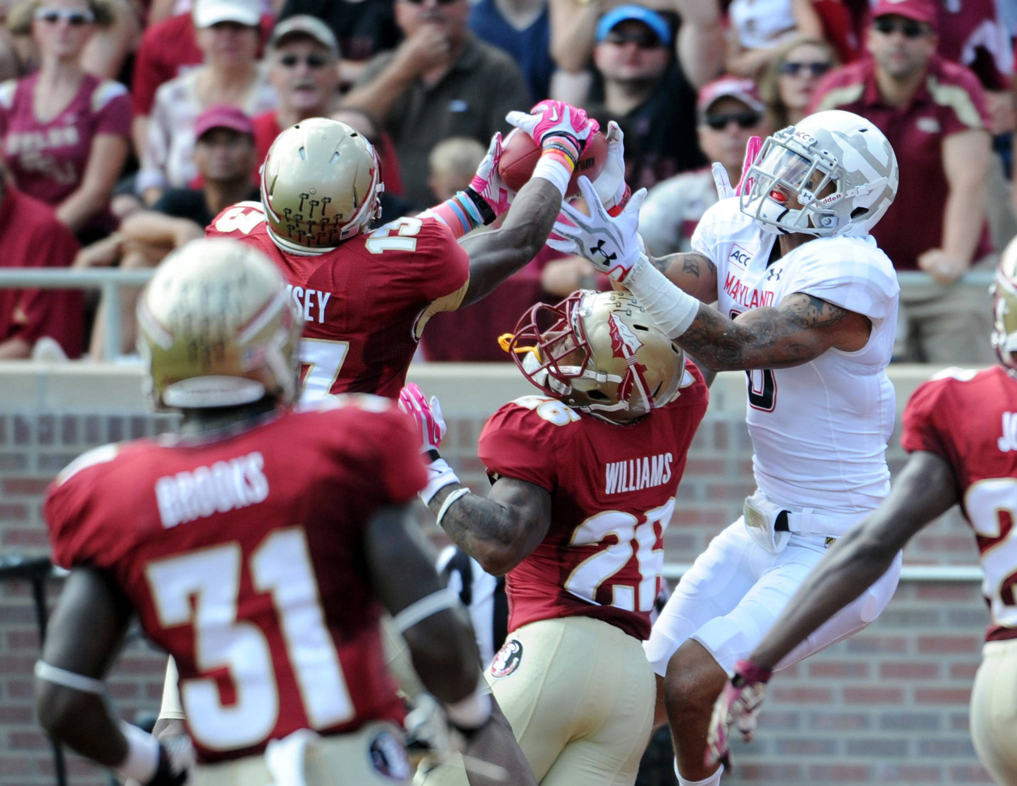 Terrapins wide receiver Deon Long (6) cannot catch the ball while being defended by Seminoles defensive back Jalen Ramsey (13) and defensive back P.J. Williams (26). Mandatory Credit: Melina Vastola-USA TODAY Sports