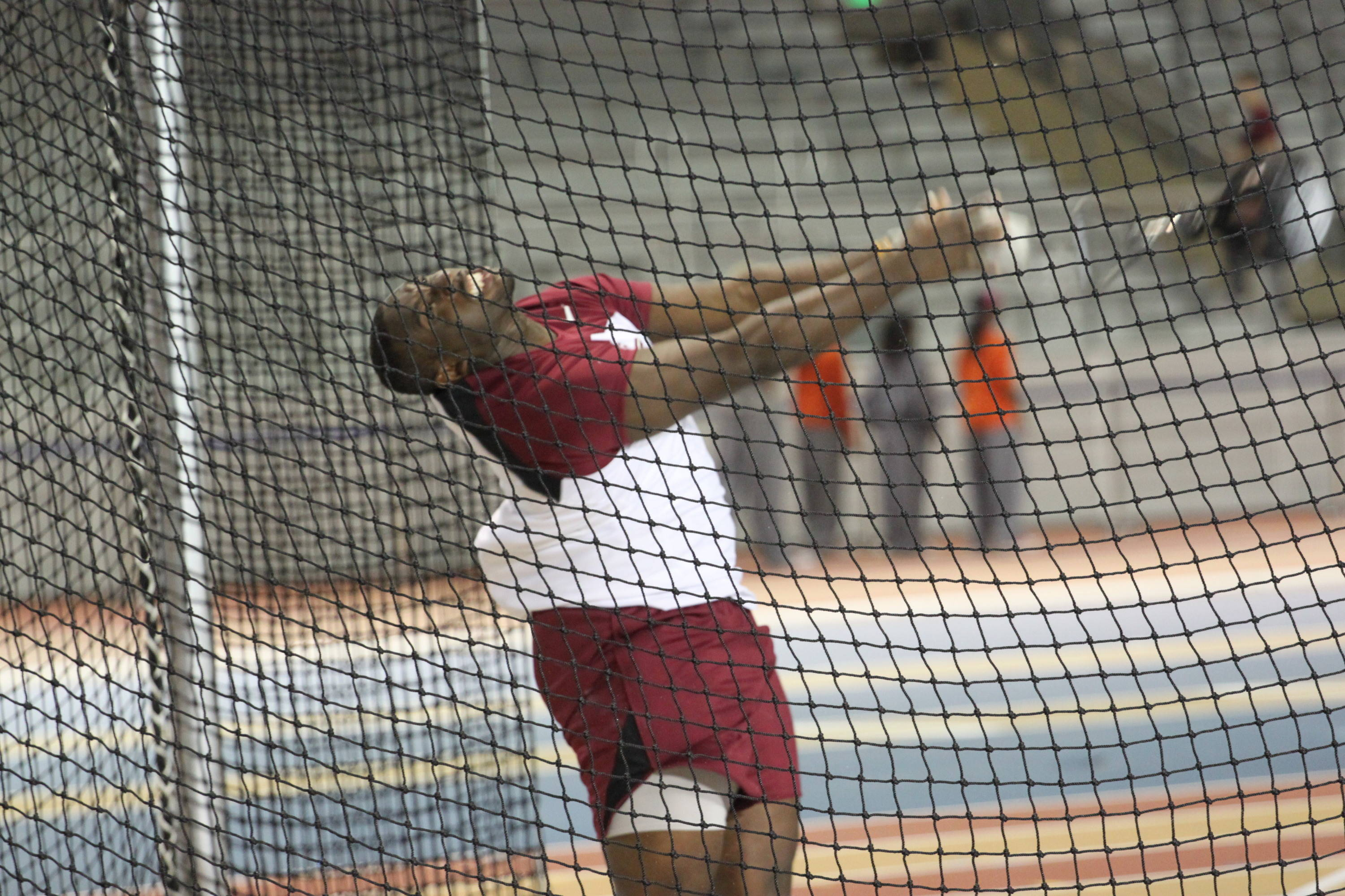 Markindey Sineus competed in Friday night's weight throw and had an impressive sixth-place finish with a throw of 17.59m (57-8 1/2) in his collegiate debut.