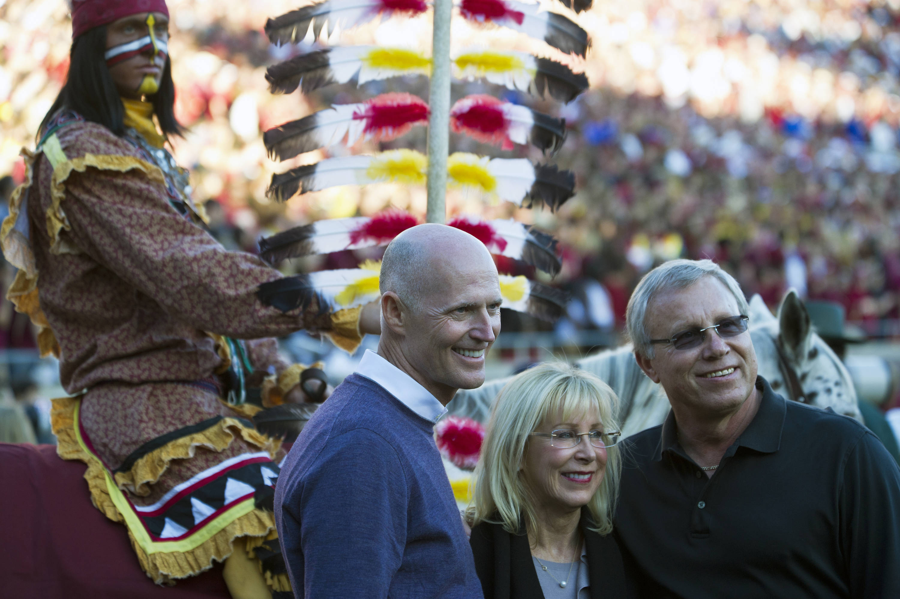 Florida Governor Rick Scott and his wife Ann pose for a photo with Renegade and Osceola