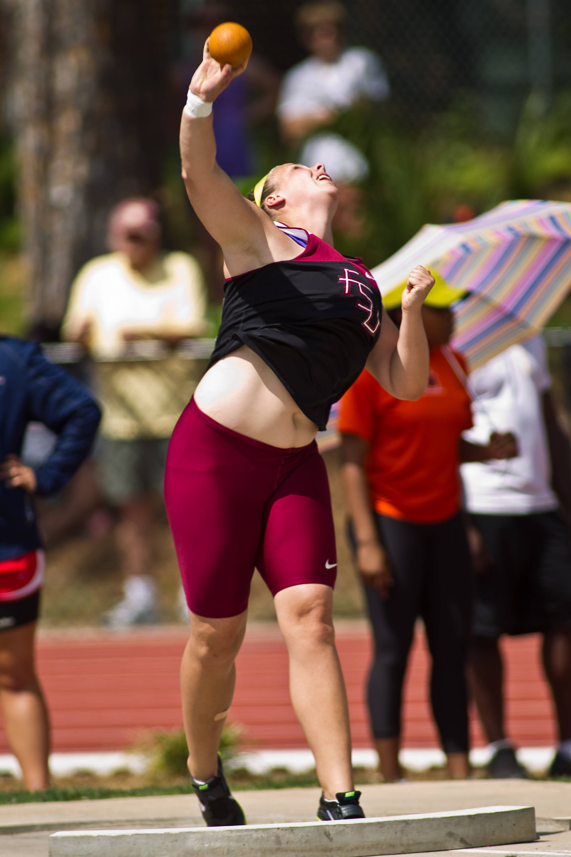 Chelsea Whalen popped an all-time best mark in the shot put to finish second.