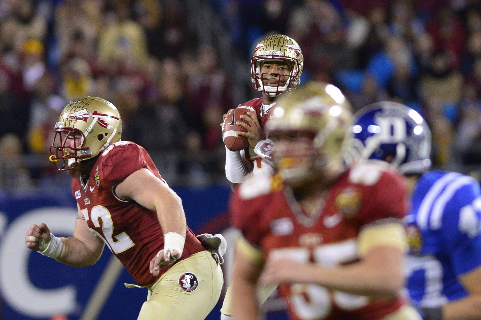 Dec 7, 2013; Charlotte, NC, USA; Florida State Seminoles quarterback Jameis Winston (5) looks to pass as offensive linesman Bryan Stork (52) blocks and tight end Nick O'Leary (35) runs his route as Duke Blue Devils linebacker David Helton (47) defends in the second quarter at Bank of America Stadium. Mandatory Credit: Bob Donnan-USA TODAY Sports