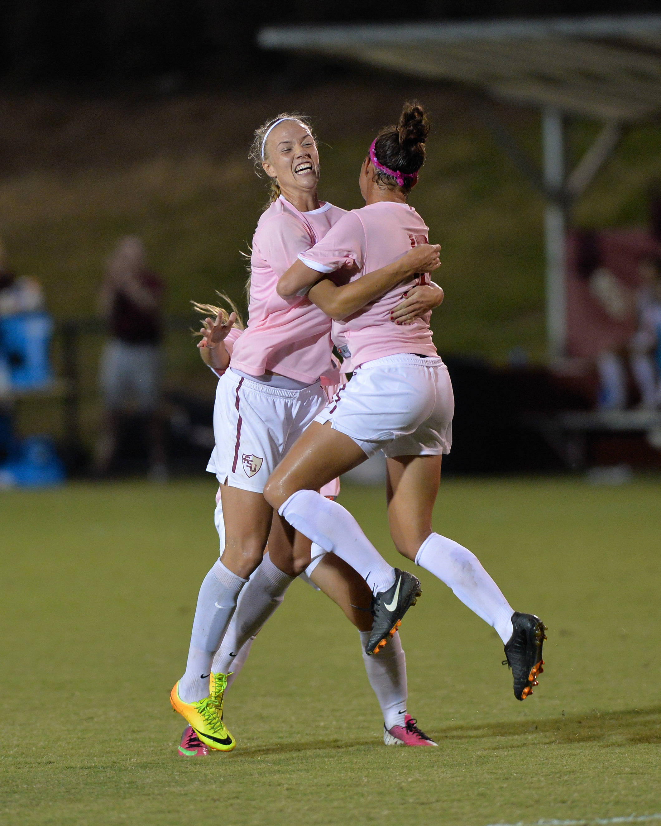 Dagny Brynjarsdottir and Carson Pickett celebrate after Pickett scores her first goal of the season.