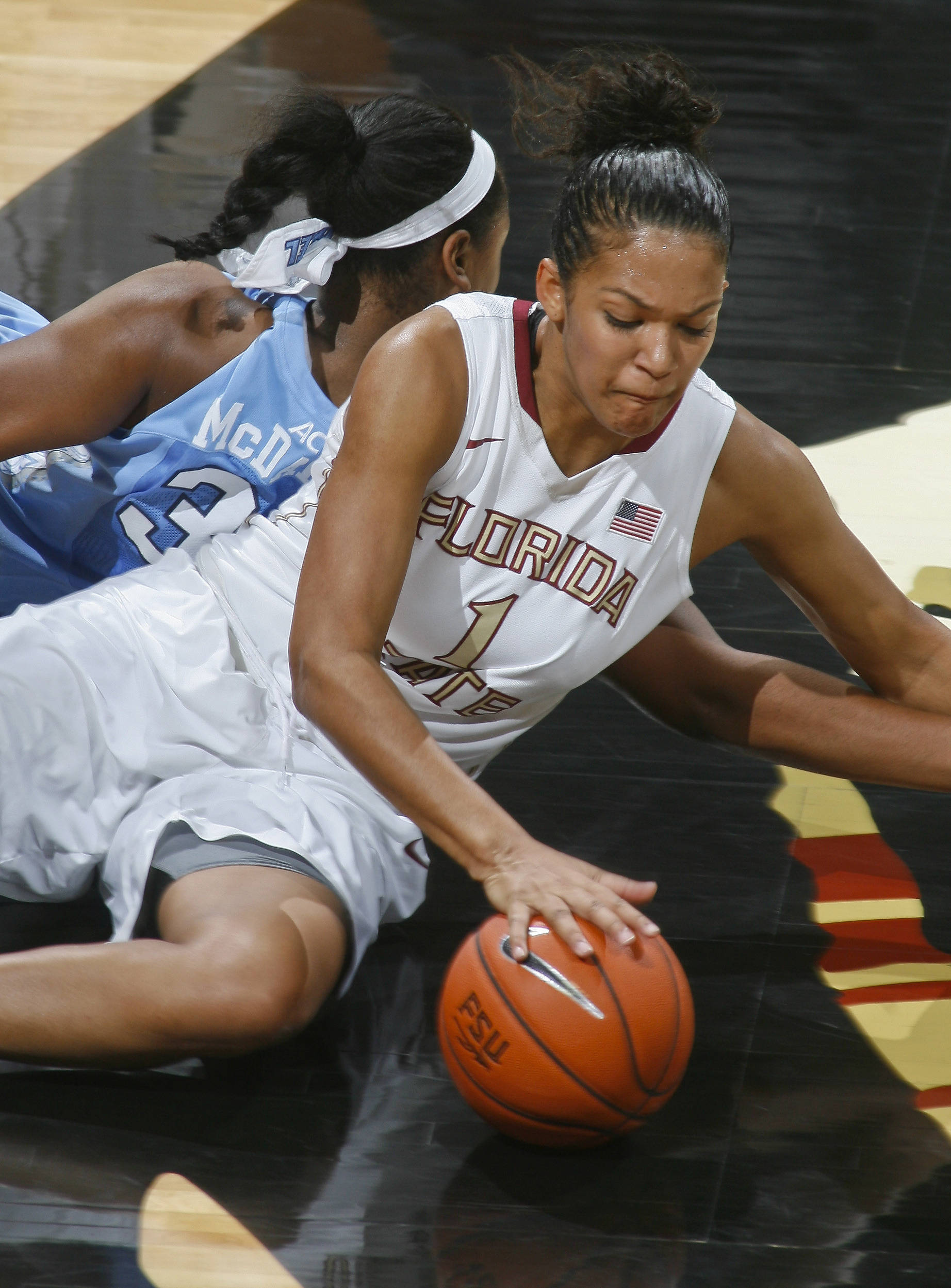 Jan 12, 2014; Tallahassee, FL, USA; Florida State Seminoles guard Morgan Jones (1) battles North Carolina Tar Heels forward Xylina McDaniel (34) for a loose ball in the first half at the Tucker Center. Mandatory Credit: Phil Sears-USA TODAY Sports
