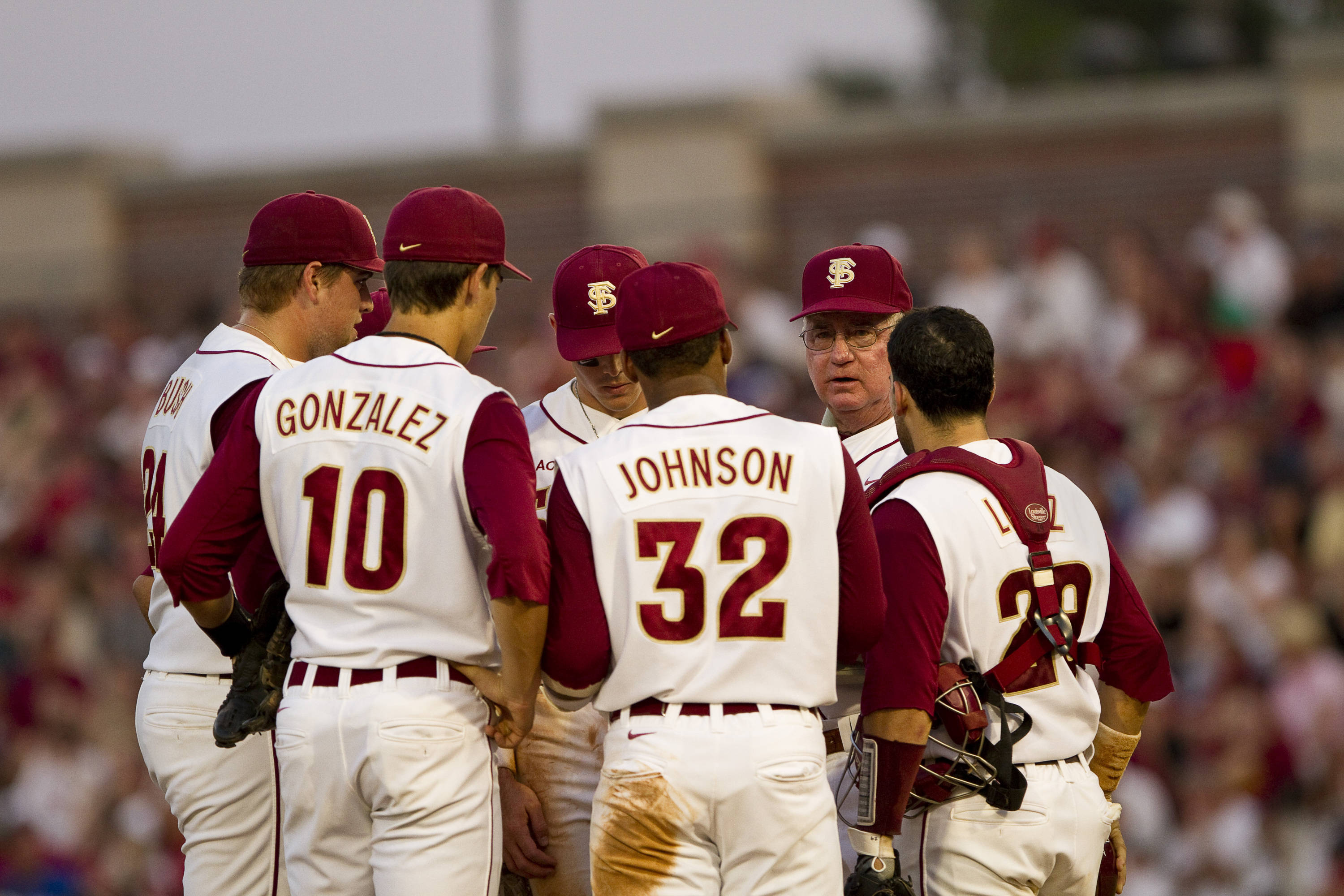 Mike Martin (11) talks with the infield.