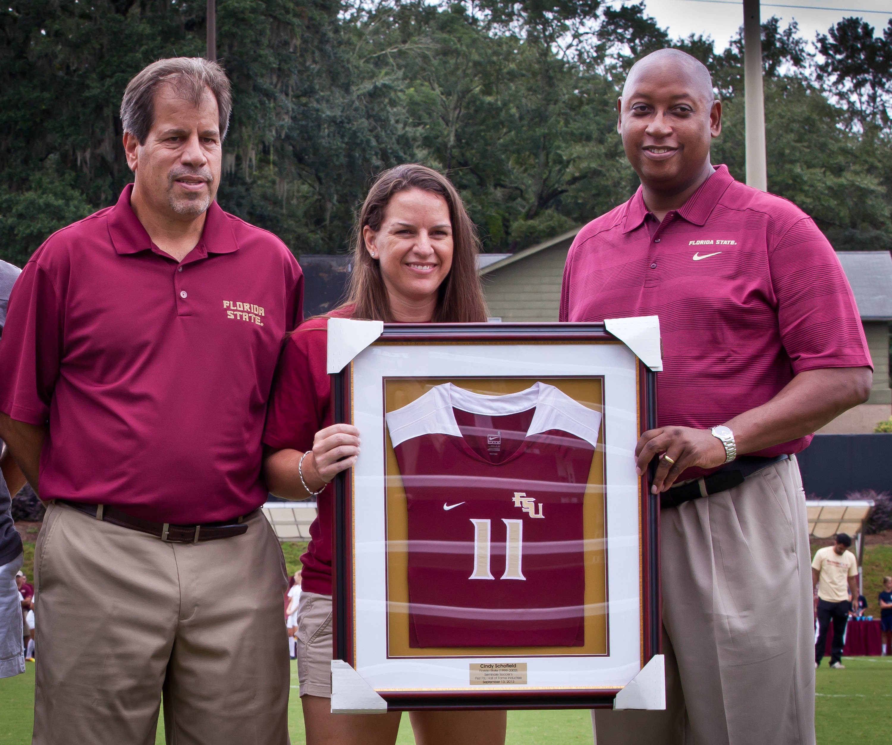 Mark Krikorian and AD Stan Wilcox recognize Cindy Schofield, women's soccer first and 2013 inductee into the FSU Sports Hall of Fame.