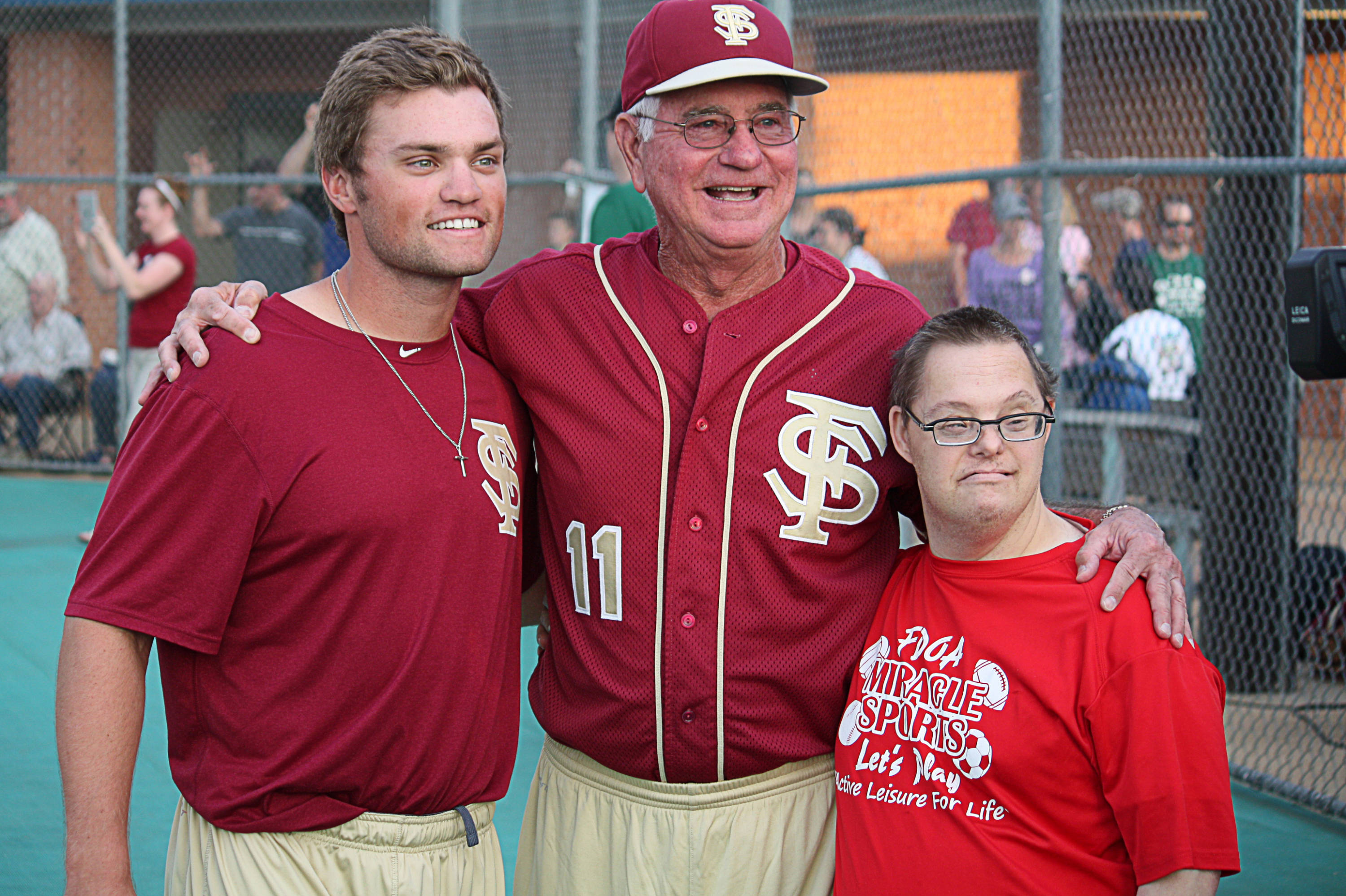 James Ramsey (23) and Mike Martin (11) pose with Miracle League's Mike Martin