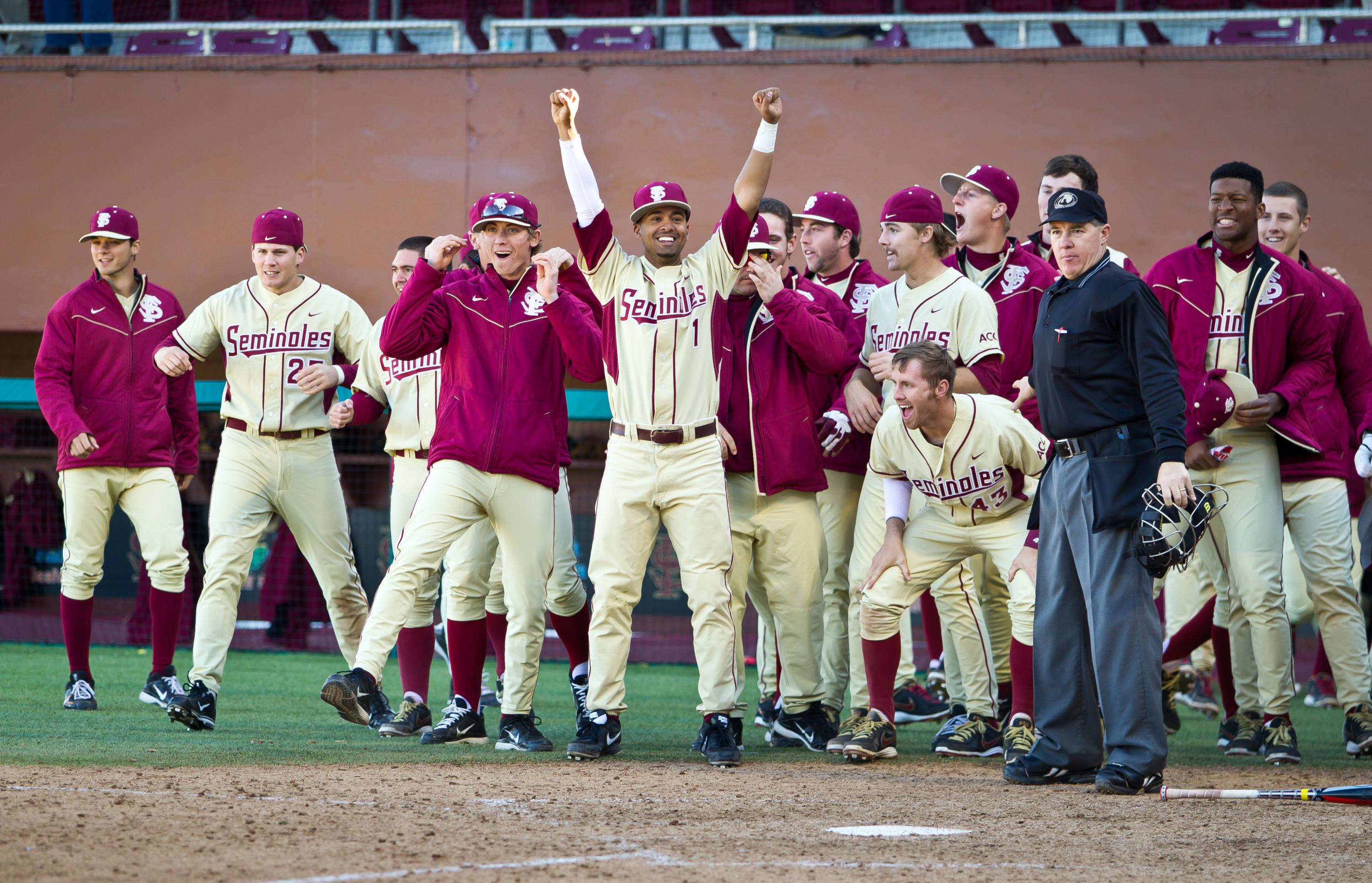 The Seminoles celebrate at home plate following Stewart's walk-off home run in the 10th inning.