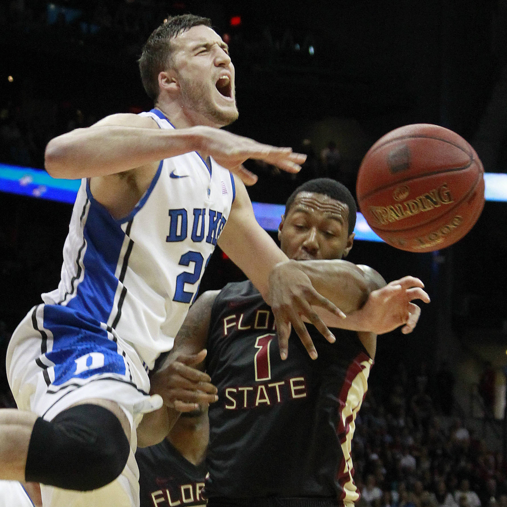 Duke forward Miles Plumlee (21) and Florida State forward/center Xavier Gibson (1) collide during the first half of an NCAA college basketball game in the semifinals of the Atlantic Coast Conference tournament, Saturday, March 10, 2012, in Atlanta. (AP Photo/John Bazemore)