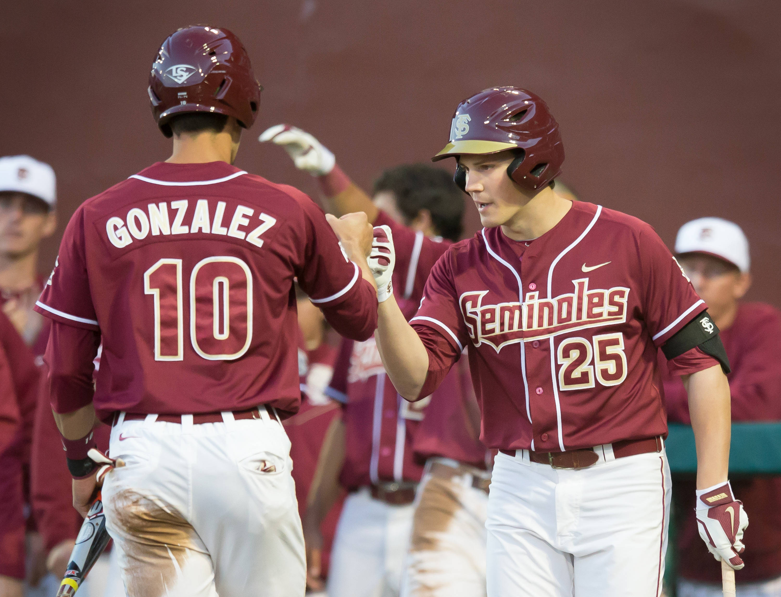Brett Knief (25) congratulates Justin Gonzalez (10) after Gonzo scored FSU's 2nd run.
