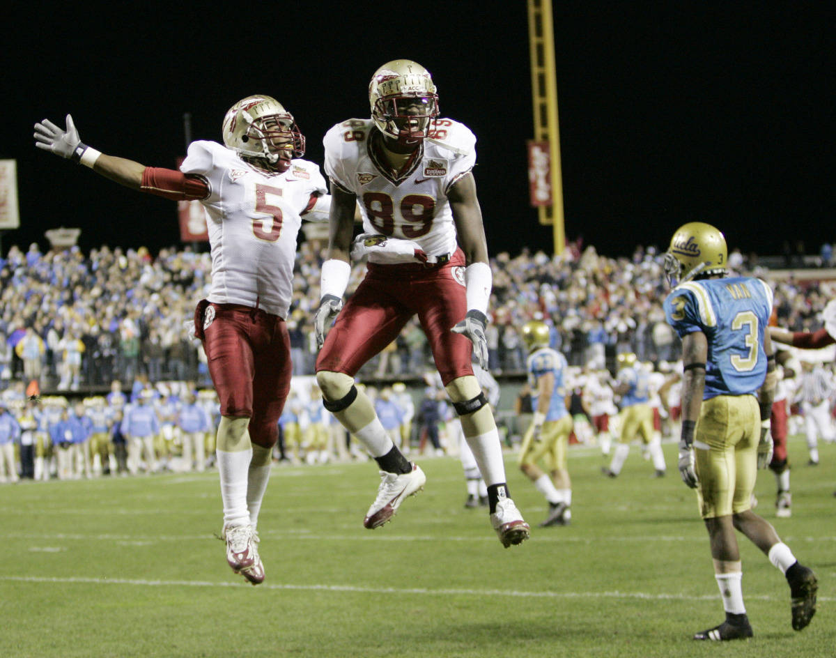 Florida State wide receiver Chris Davis (5) and teammate Greg Carr (89) celebrate after Carr's 30-yard touchdown catch against UCLA during the fourth quarter of the Emerald Bowl college football game in San Francisco, Wednesday, Dec. 27, 2006. UCLA cornerback Rodney Van, is at right. (AP Photo/Marcio Jose Sanchez)