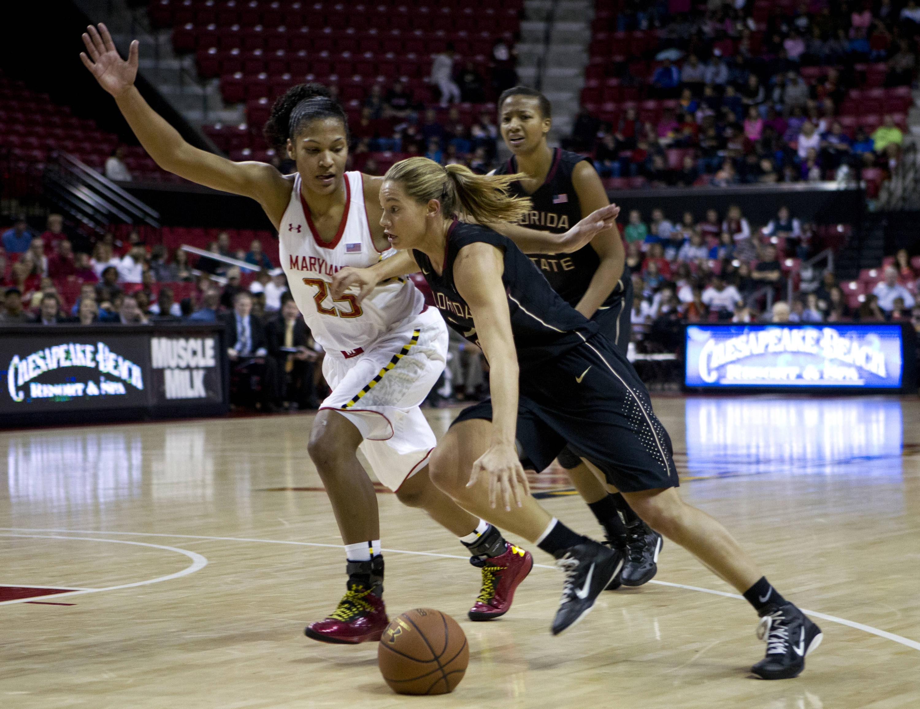 Florida State's Alexa Deluzio (3) moves the ball against Maryland's Alyssa Thomas (25) during the first half. (AP Photo/Jose Luis Magana)